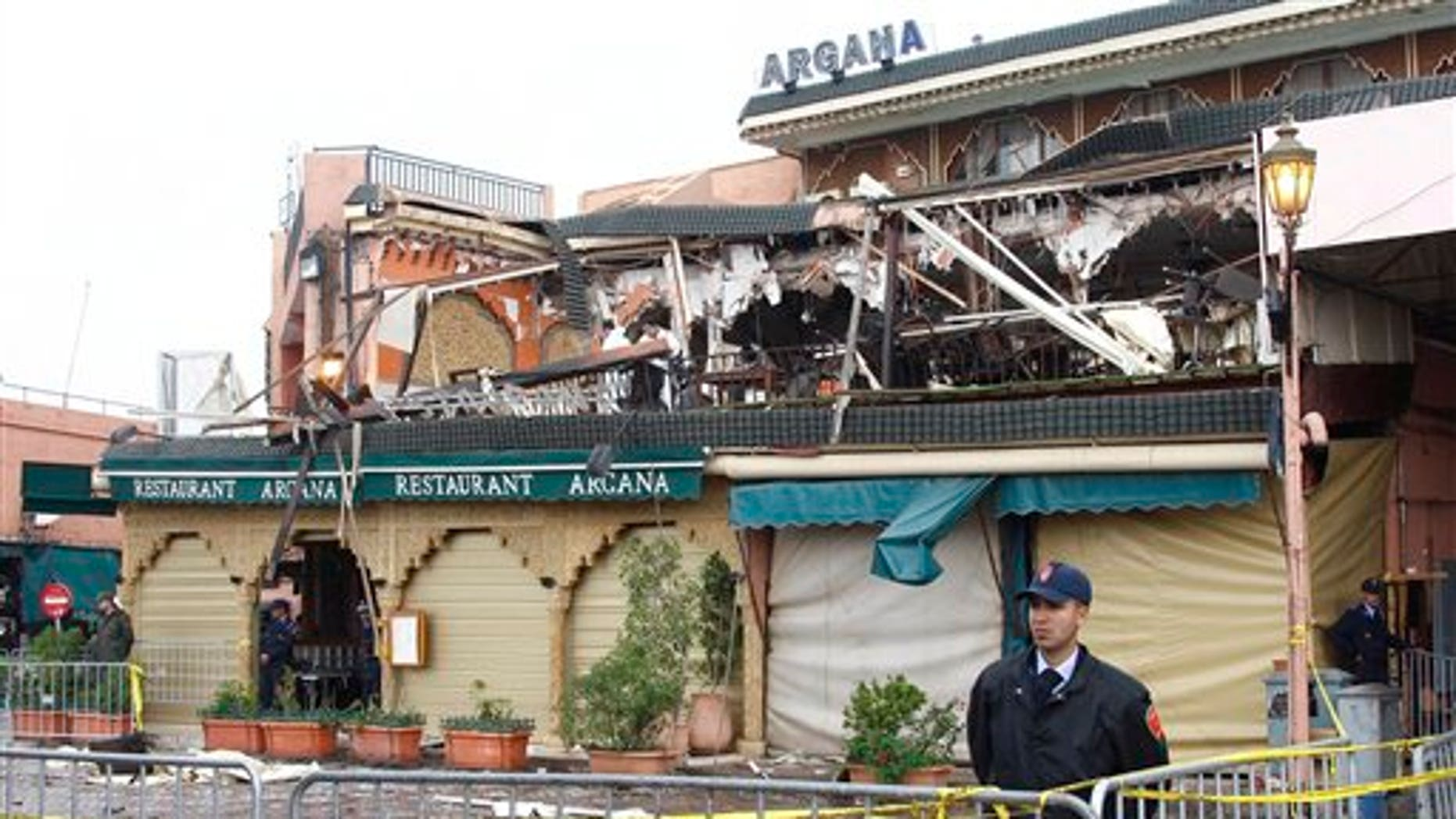 April 28: Police guard a damaged building after an explosion Thursday ripped through a cafe popular among foreign tourists in Marrakech, Morocco. The international police agency Interpol called the attack on a crowded tourist cafe in Marrakech a suspected suicide bombing Friday, as the government said two Canadians, two French citizens, a Dutchman and two Moroccans were among the 15 killed in the explosion. (AP)
