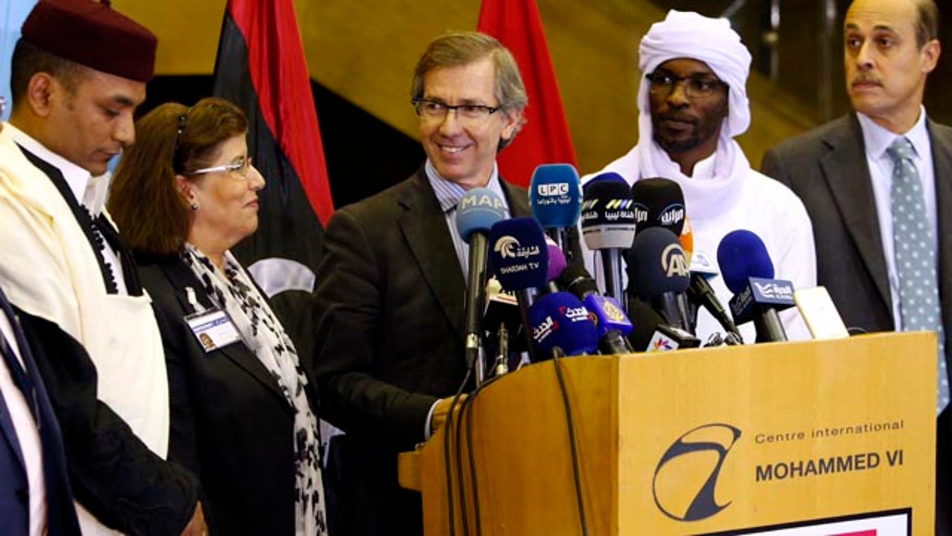 Oct. 8, 2015: United Nations envoy for Libya Bernardino Leon, center, makes an announcement to the media in Skhirat, Morocco. Leon proposed a national unity government for Libya after months of difficult talks between the north African country's two rival governments, but now it's up to the two sides and Libyans themselves to approve it. (AP Photo/Abdeljalil Bounhar)