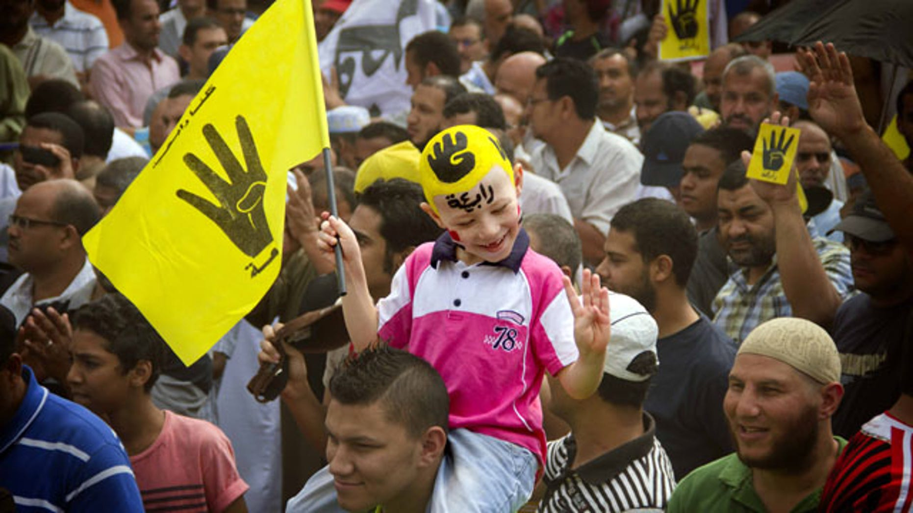 September 27, 2013: A young Egyptian boy participates in a demonstration by supporters of ousted President Mohammed Morsi in the Maadi district of Cairo, Egypt. (AP Photo/Hamada Elrasam, File)