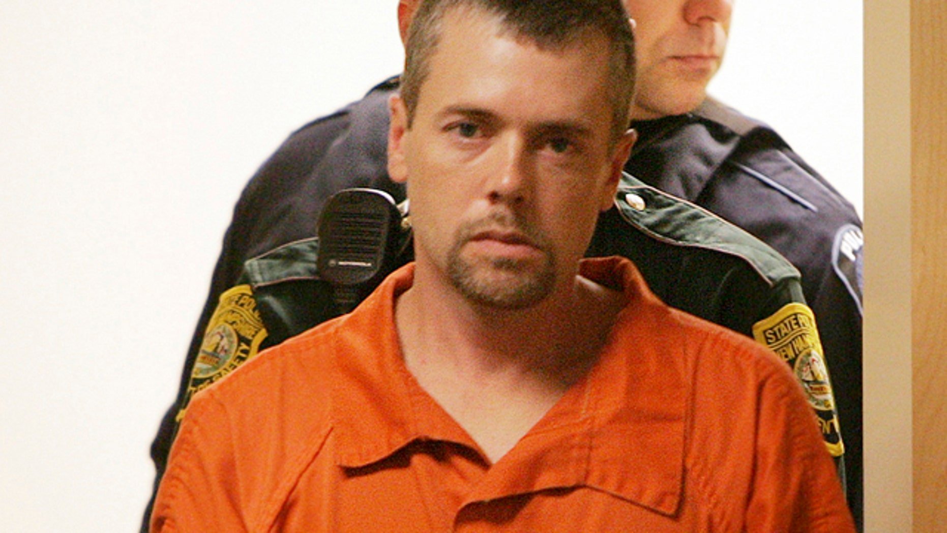 Nov. 10, 2010: Christopher Smeltzer arrives for arraignment in District Court in Candia, N.H.