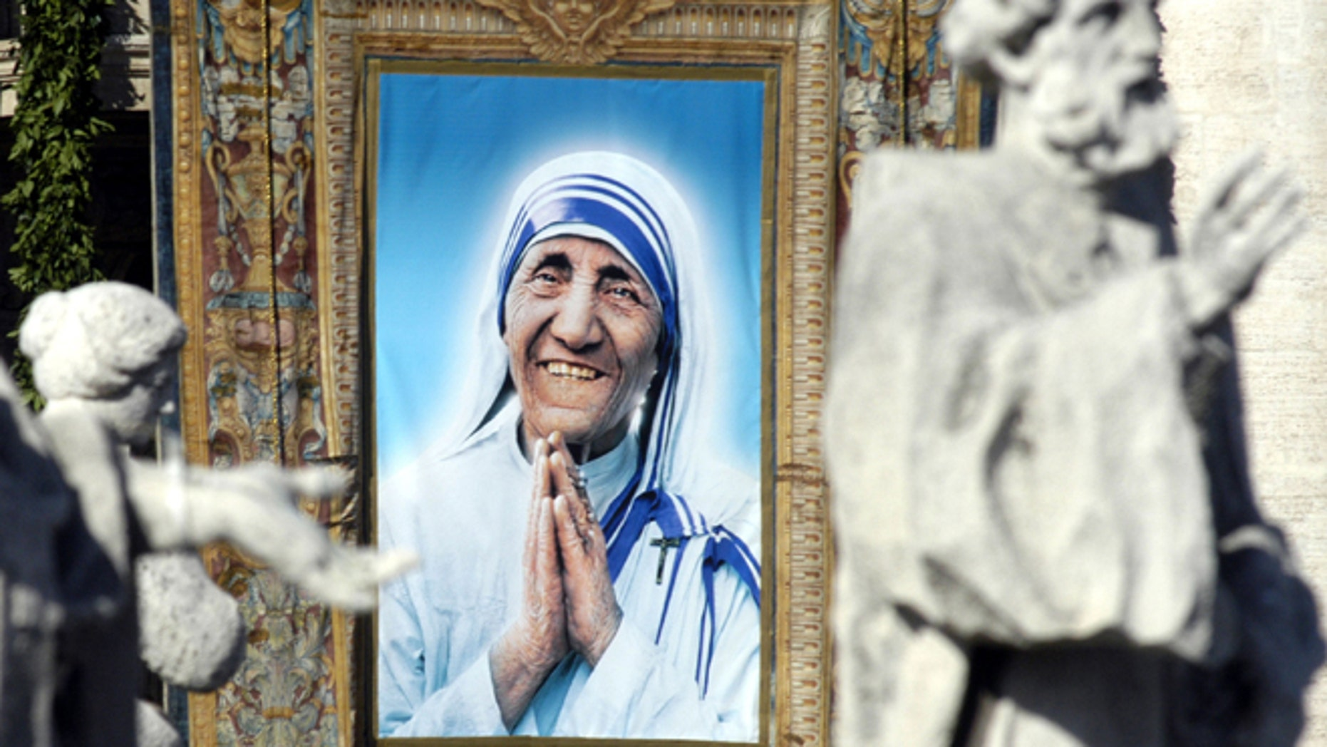 VATICAN  CITY - OCTOBER 19:  A tapestry depicting  Mother Teresa framed by the statues of  St. Peter's Colonnade during the beatification ceremony led by Pope John Paul II October 19, 2003 in Vatican City, Italy. Mother Teresa won the Nobel Peace Prize in 1979 for all of her charity work. She died in 1997.  (Photo by Franco Origlia/Getty Images)
