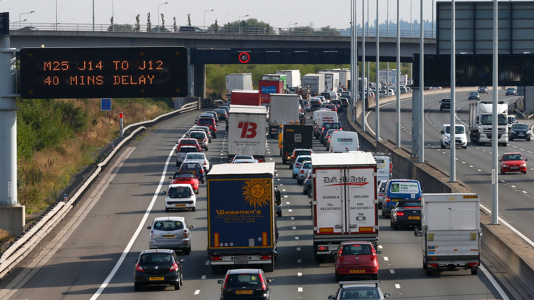 Heavy traffic is seen on the M25 motorway near Heathrow Airport west of London August 16, 2013. REUTERS/Eddie Keogh (BRITAIN - Tags: TRANSPORT TRAVEL) - RTX12O1T