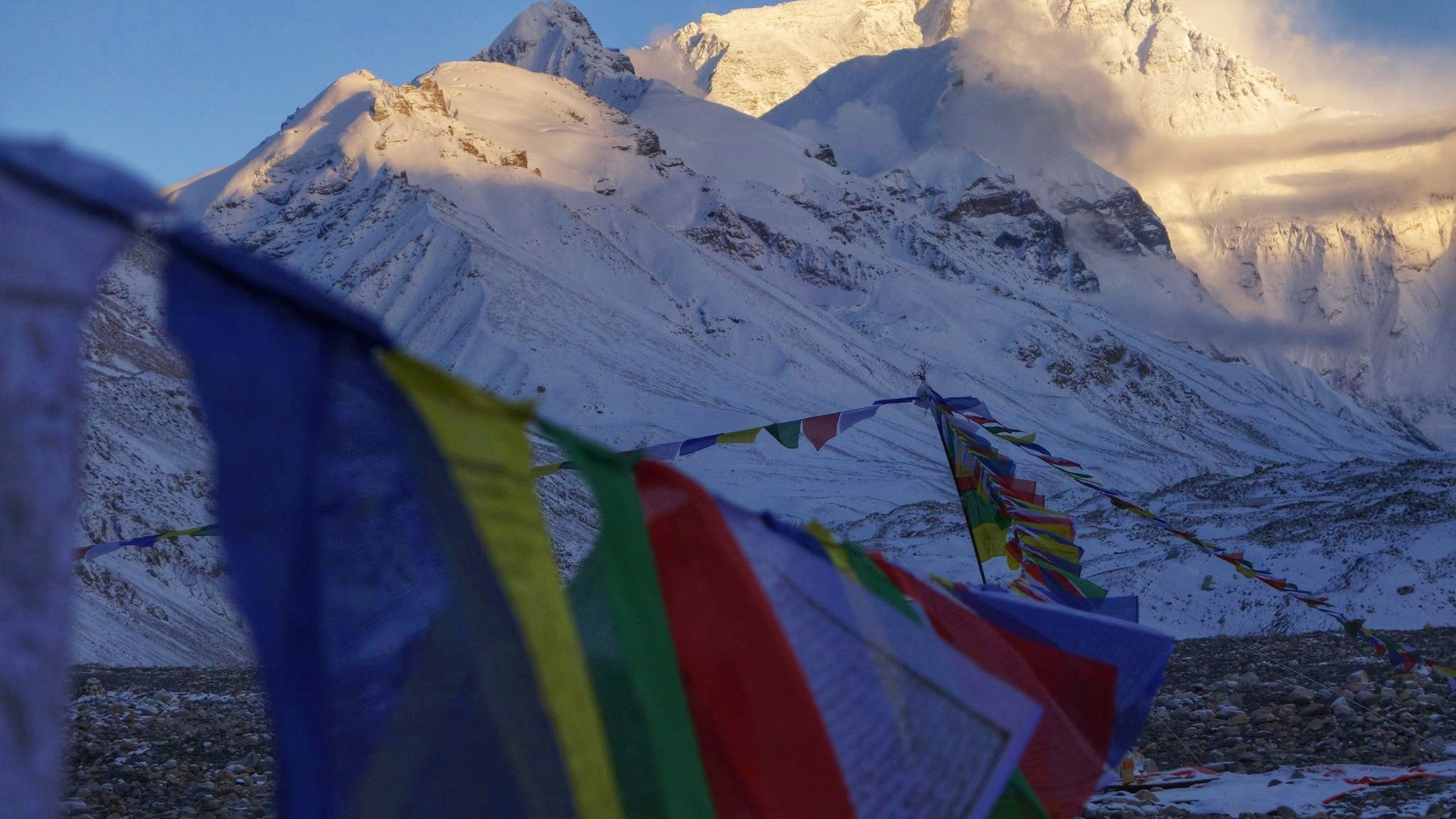 This undated photo provided by Alpenglow Expeditions, Mount Everest is seen from a base camp on the northern Tibetan side of the mountain.