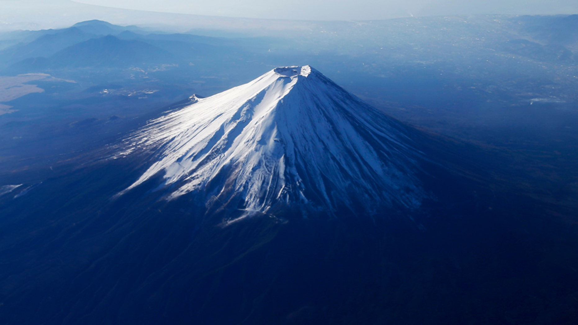 File photo - Japan's Mount Fuji is seen covered with snow from an airplane December 5, 2013.