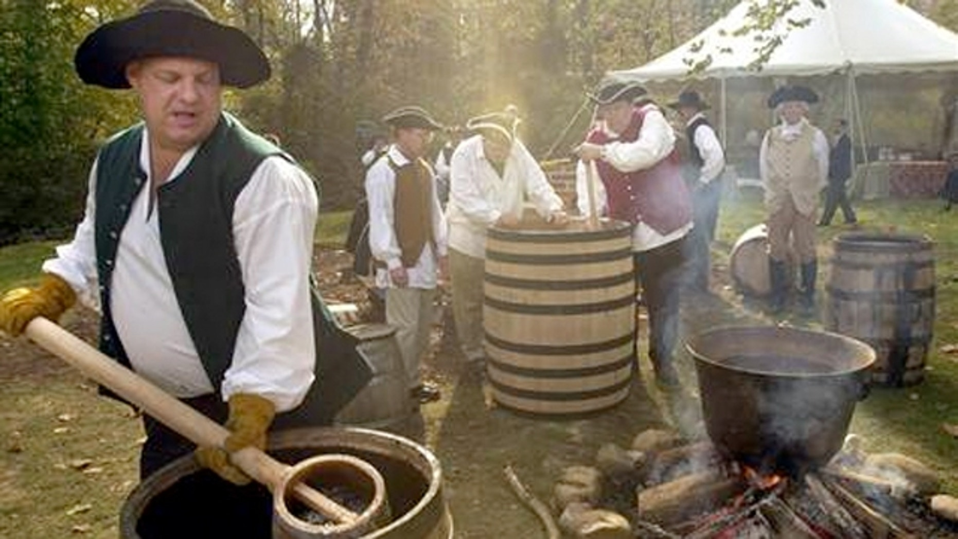 Master distillers at Mount Vernon's Gristmill and Distillery