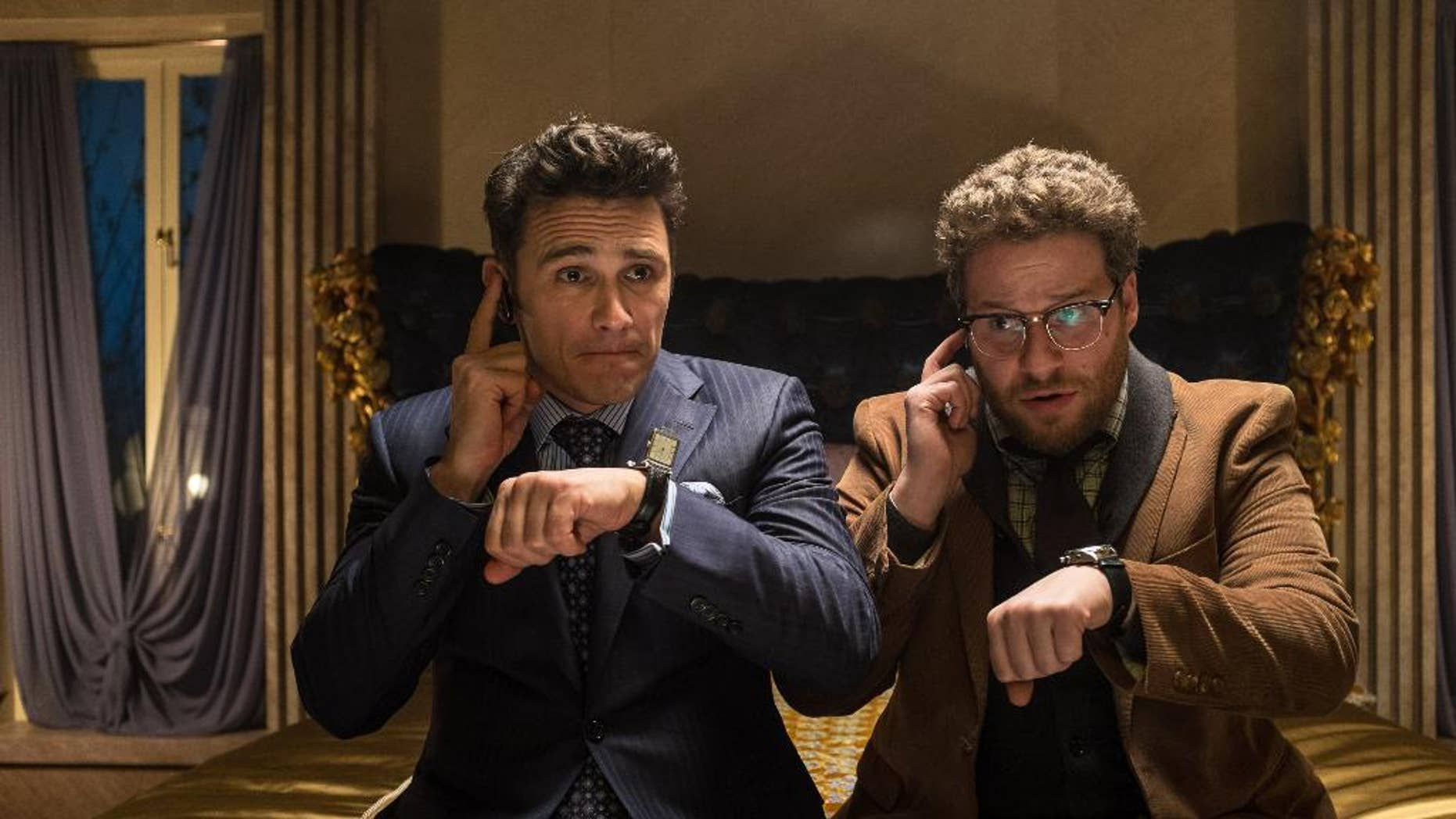 "This image released by Columbia Pictures shows James Franco, left, and Seth Rogen in ""The Interview."" The comedy is set for release in 2014 on Christmas Day. (AP Photo/Columbia Pictures, Sony, Ed Araquel)"