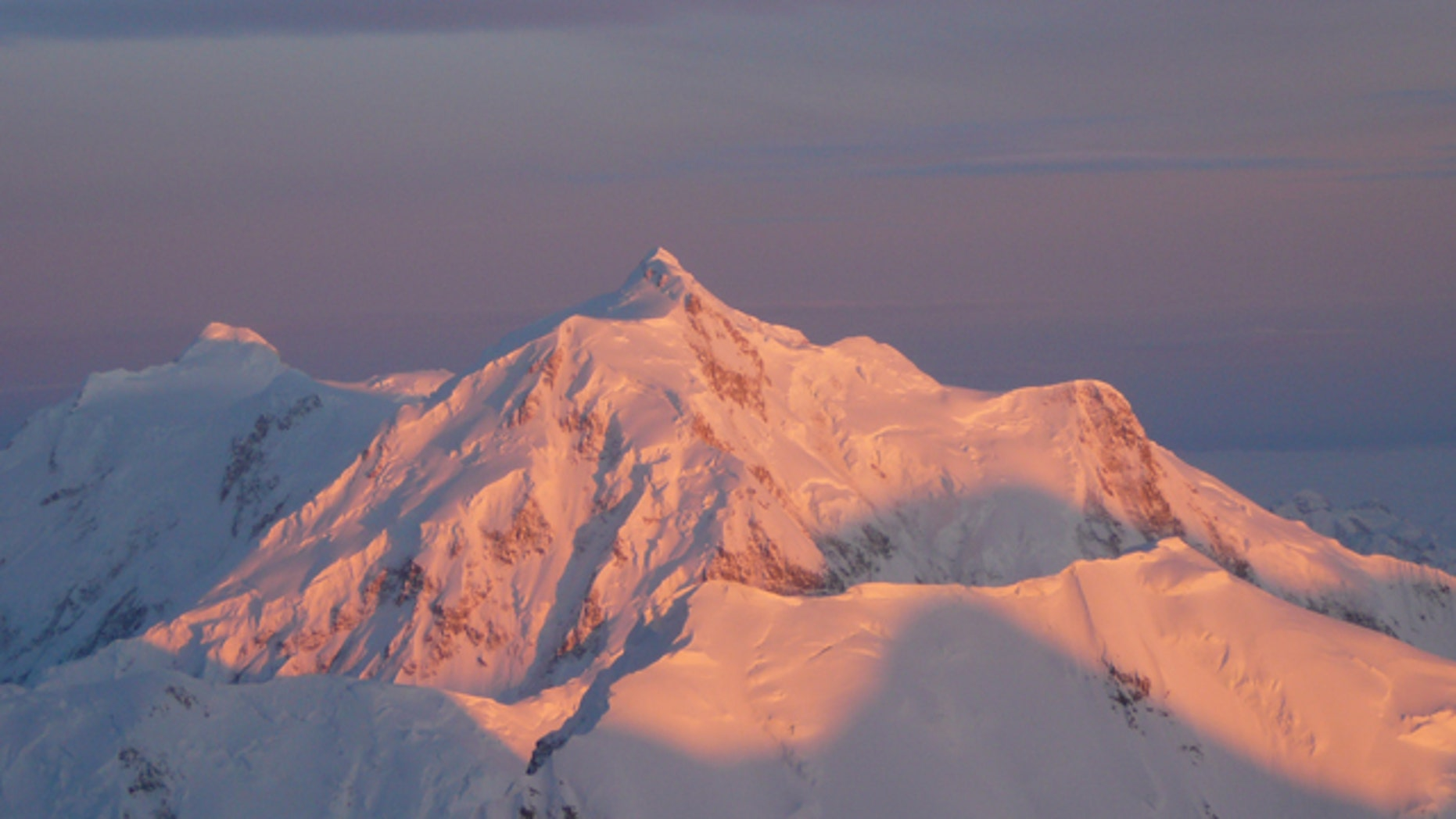 Beautiful but deadly? Light escapes through a break in the clouds over Mt. Hunter in Denali National Park.