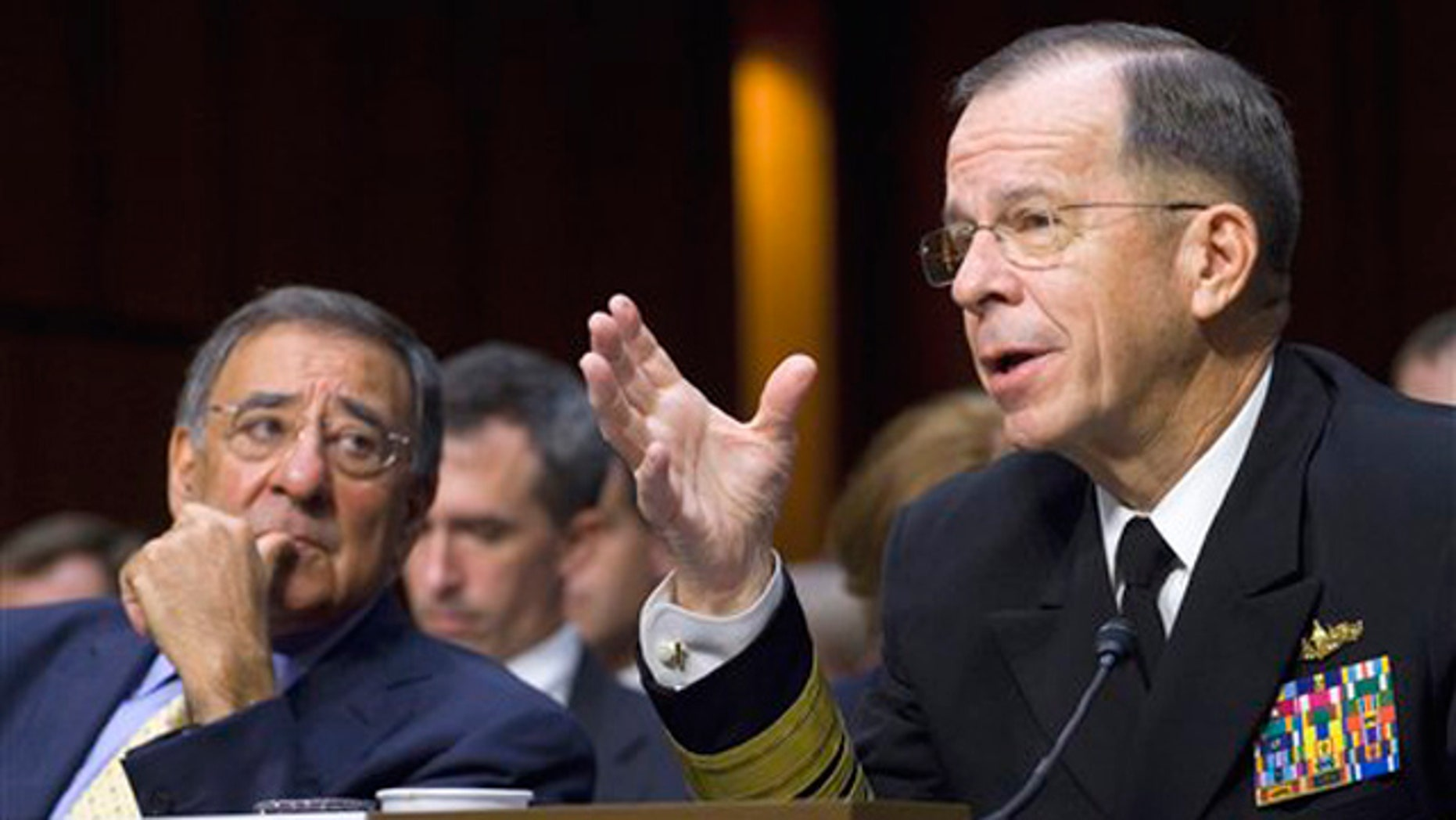 Defense Secretary Leon Panetta looks on at left as Joint Chiefs Chairman Adm. Michael Mullen, testifies on Capitol Hill in Washington, Thursday, Sept. 22, 2011, before the Senate Armed Services Committee hearing on U.S. strategy in Afghanistan and Iraq.