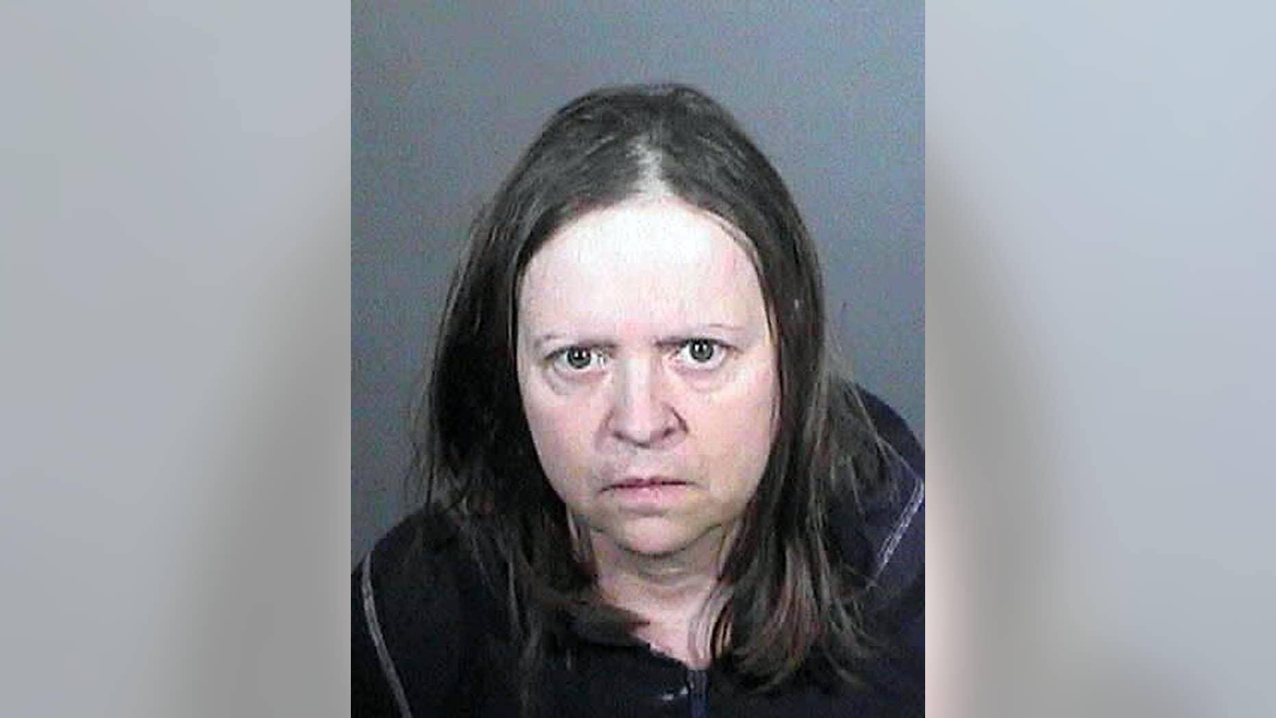 This undated law enforcement booking photo from the Los Angeles County Sheriff's Office shows Cathryn Parker. Parker accused of stealing the identities of people working behind the scenes in Hollywood film production has lived under at least 74 aliases, Los Angeles County sheriff's officials said. As of Friday, April 17, 2015, Parker was in federal custody in Northern California, where she was wanted for probation violations. (Los Angeles County Sheriff's Office via AP)