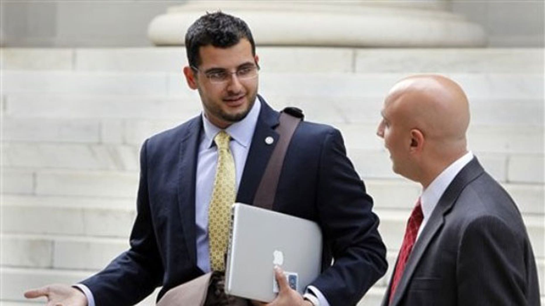 September 12, 2011: Muneer Awad, left, executive director of the Council on American-Islamic Relations in Oklahoma talks with attorney Gadeir Abbas as they leave federal court in Denver.