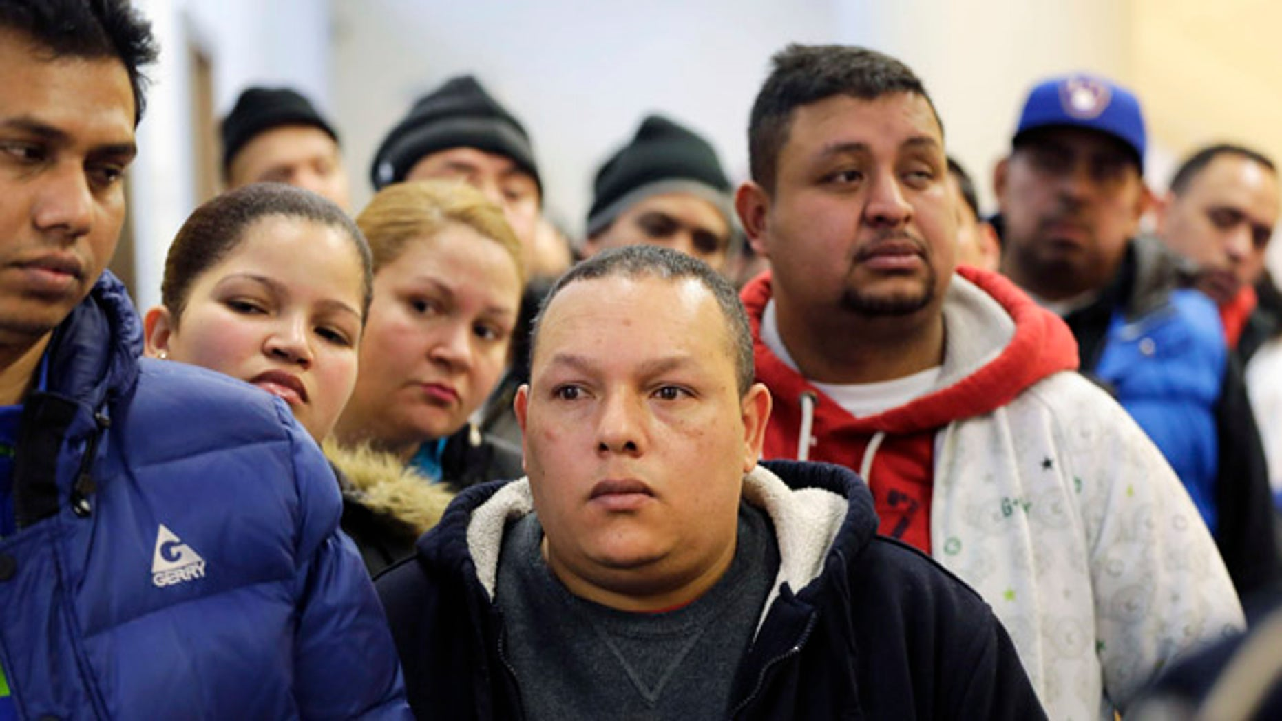 People wait in line to apply for municipal identification cards in the Bronx borough of New York on Jan. 12, 2015.