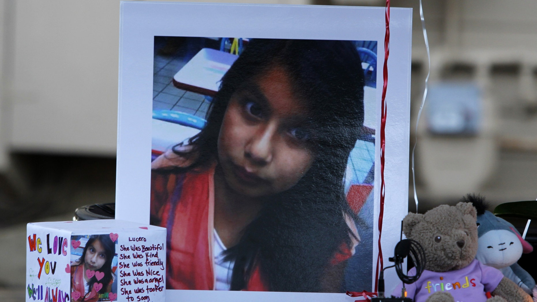 A picture of Lucero Gutierrez, an 11-year-old who was killed in a murder-suicide by her brother Abel Gutierrez, is part of a memorial in Gilroy, Calif., on Thursday, March 15, 2012.  Investigators said they were  searching for the mother of the shooter who they fear also may have been killed or seriously injured.    (AP Photo/Nhat V. Meyer/Staff)