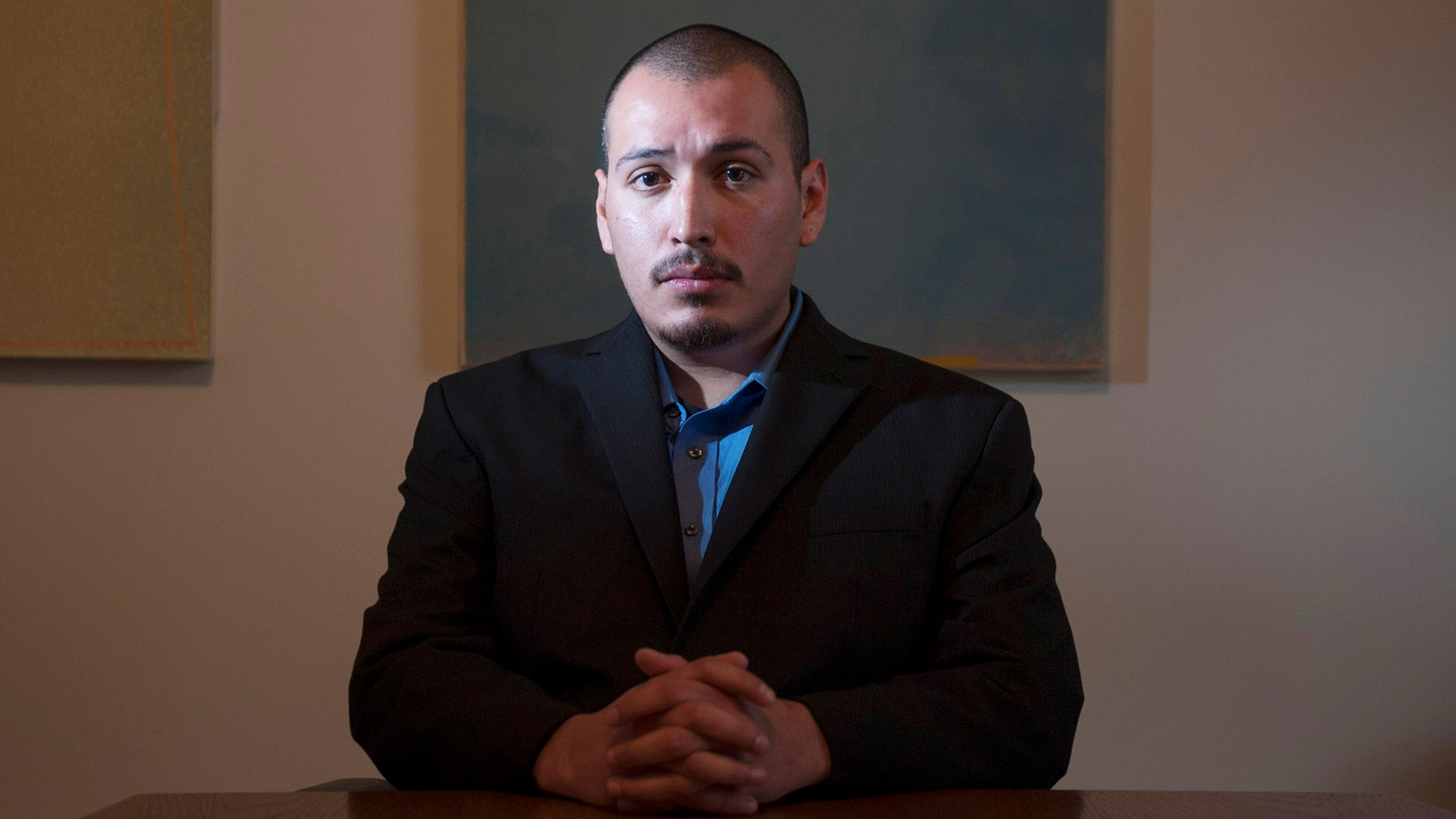 In this Dec. 7, 2013 photo, Eder Herrera poses for a photo. The Southern California city of Brea will pay $700,000 to Herrera who was arrested in the 2011 killings of his mother and brother but was freed when his high school friend confessed to the crimes, lawyers said Tuesday, April 28, 2015. (Miguel Vasconcellos/The Orange County Register via AP)