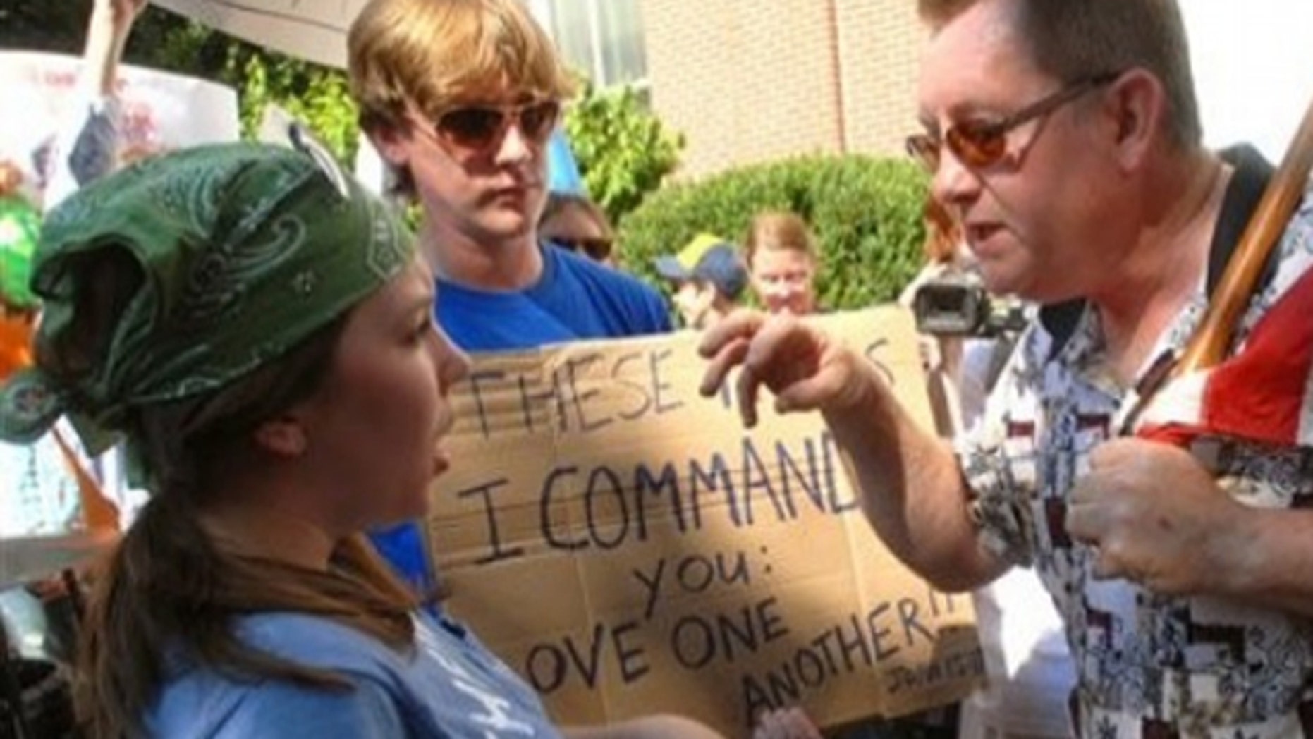 July 14, 2010: Mosque protester Greg Johnson, right, and counter protester Ina Marshall and Tim Foster argue in front of the Rutherford County Courthouse in Murfreesboro, Tenn., about a planned mosque and Islamic community center.