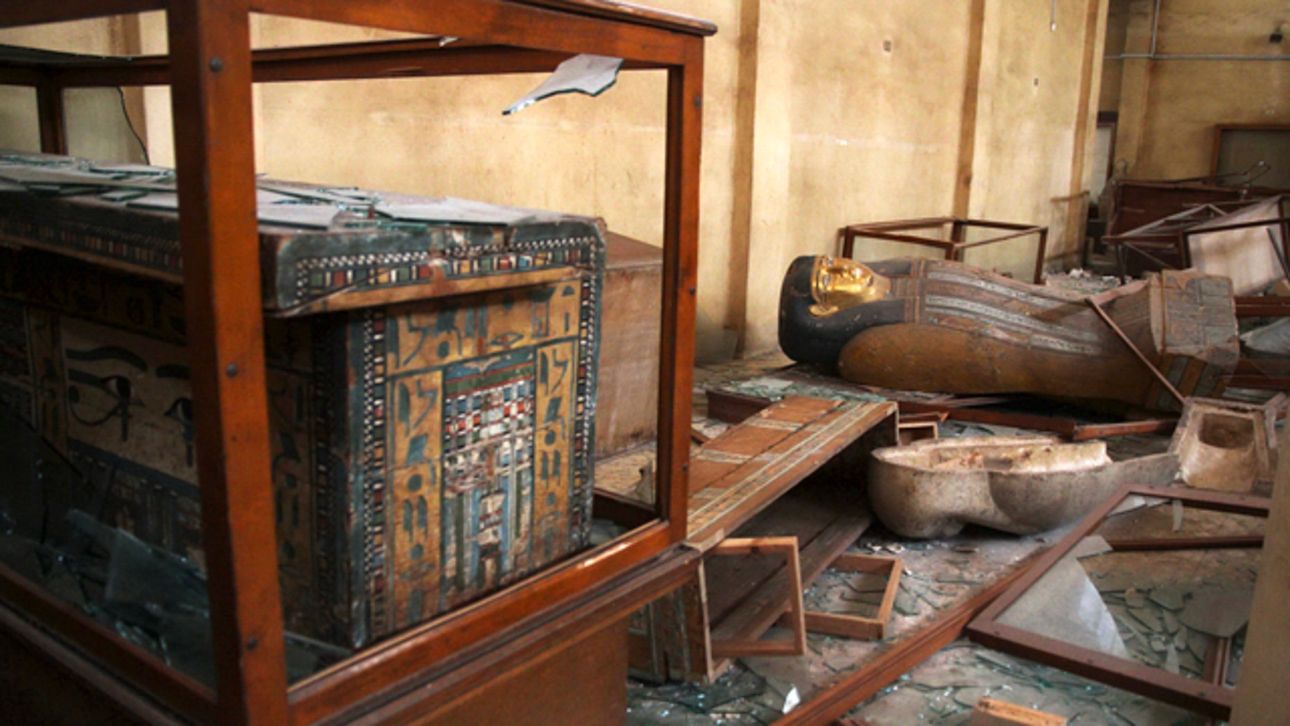 Aug. 17, 2013: Damaged pharaonic objects lie on the floor and in broken cases in the Malawi Antiquities Museum after it was ransacked and looted.