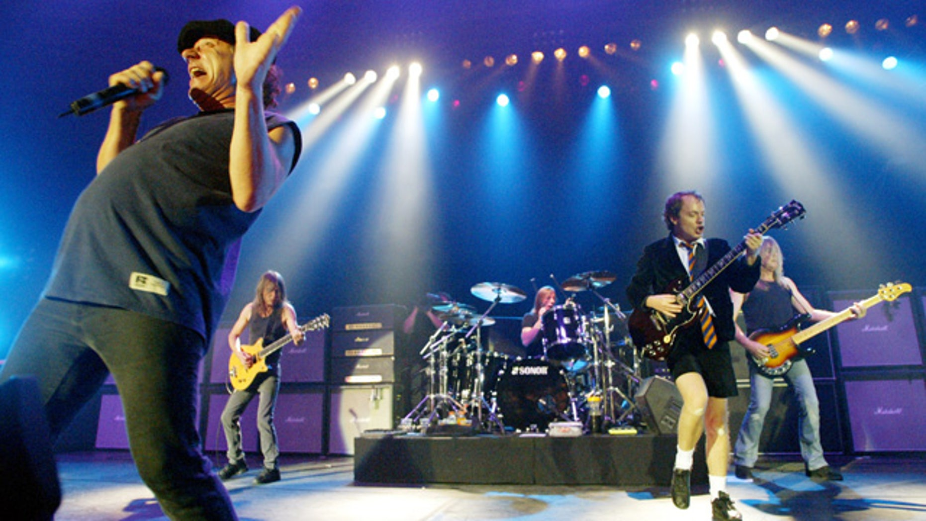 FILE - This June 17, 2003 file photo shows British rock band AC/DC, from left, Brian Johnson, Malcolm Young, Phil Rudd, Angus Young, and Cliff Williams performing on stage during a concert in Munich, southern Germany. Malcolm Young of AC/DC is taking a break from the band to focus on his health. (AP Photo/Jan Pitman, File)