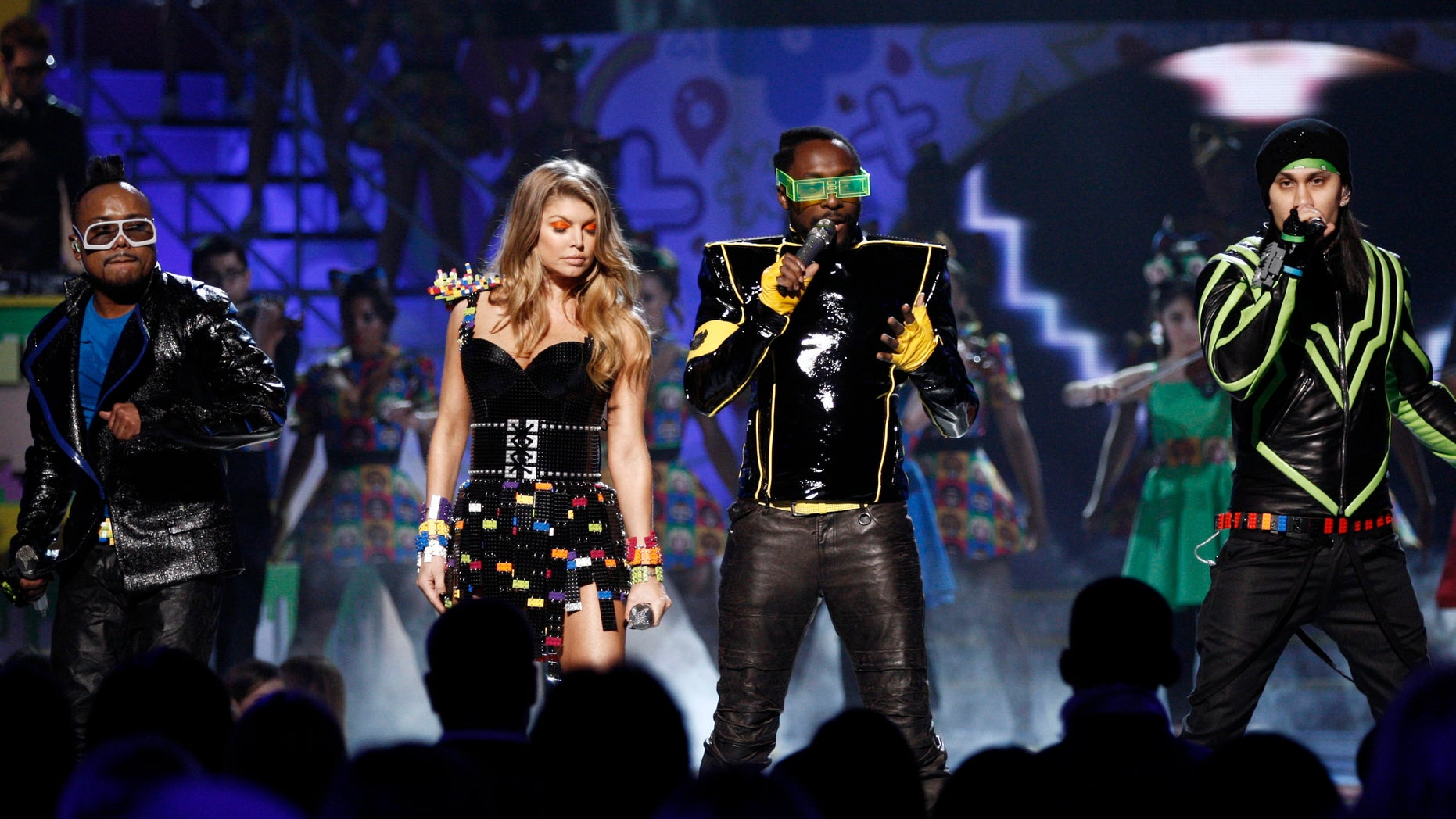 "FILE - In this April 2, 2011 file photo, The Black Eyed Peas perform at Nickelodeon's 24th Annual Kids' Choice Awards in Los Angeles. Black Eyed Peas are reuniting after a five-year hiatus for a new rendition of their song ""Where Is The Love?"" aimed at ending gun violence. (AP Photo/Matt Sayles, File)"