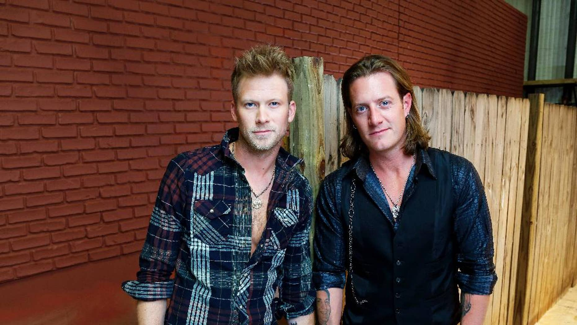 "In this Sept. 24, 2014 photo, members of Florida Georgia Line, Brian Kelley, left, and Tyler Hubbard pose for a photo in Nashville, Tenn., to promote their latest album, ""Anything Goes."" (Photo by Donn Jones/Invision/AP)"