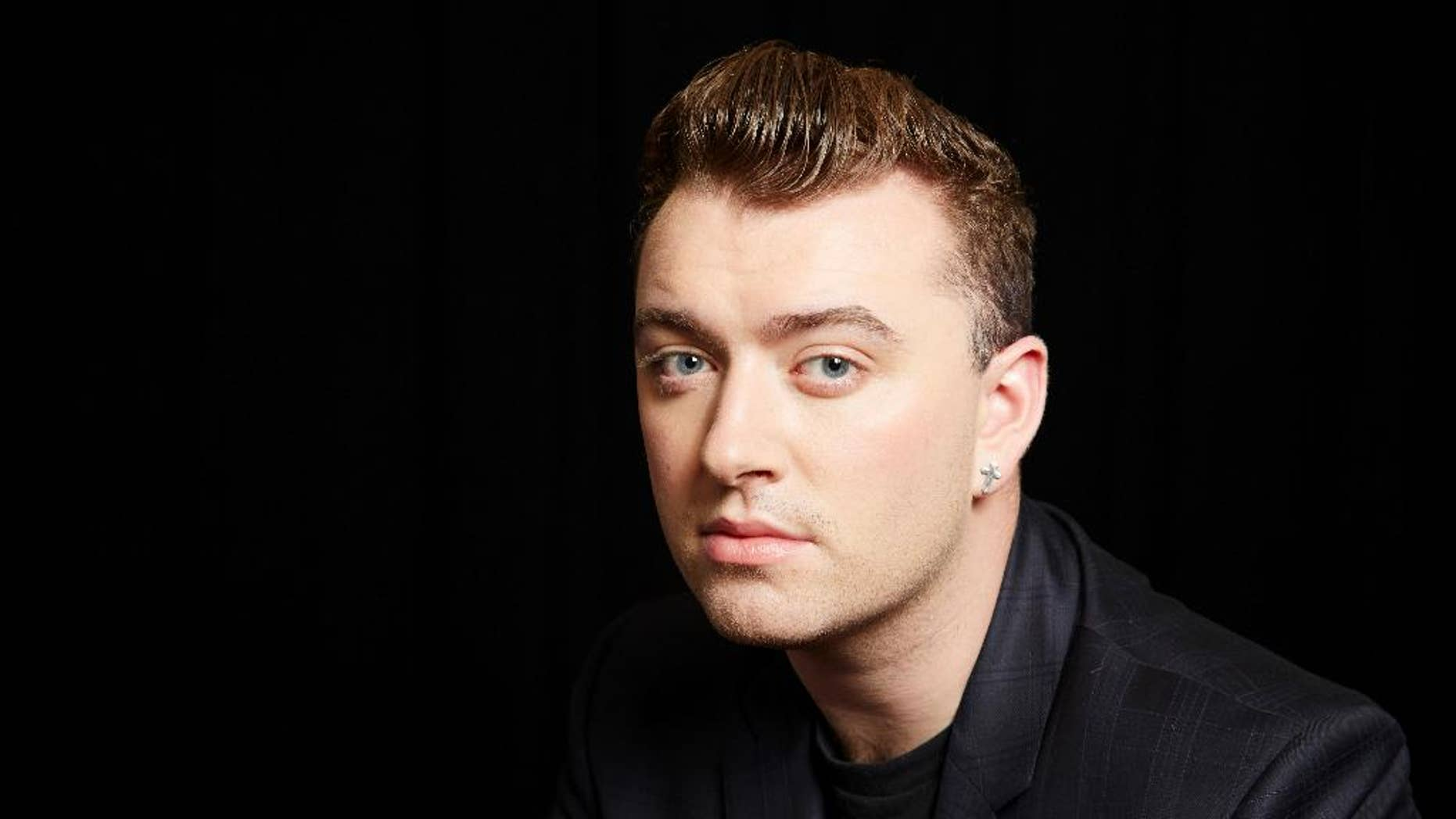 FILE - In this Wed., Sept. 17, 2014 file photo, British soul singer Sam Smith poses for a portrait, in New York. Smith is competing against Beck, Beyonce, Ed Sheeran and Pharrell for album of the year at this year's Grammy Awards on Sunday, Feb. 8. (Photo by Dan Hallman/Invision/AP, File)