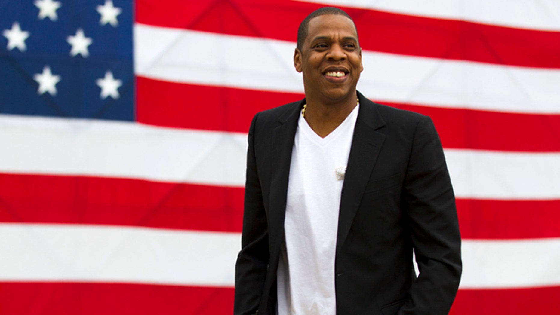 """May 14, 2012: In this file photo, entertainer Shawn """"Jay-Z"""" Carter smiles in between interviews, after a news conference at Philadelphia Museum of Art in Philadelphia."""