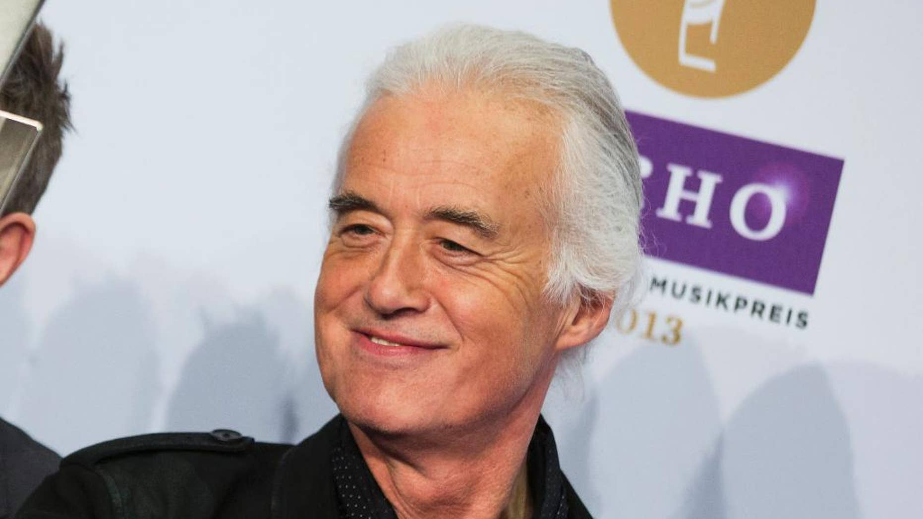 FILE - This March 21, 2013 file photo shows Jimmy Page, of Led Zeppelin,  during the German  Echo music award ceremony in Berlin, Germany. Page has remastered the band's entire catalog. After spending the past couple of years listening to hundreds of hours of the band's music, nine freshly mastered studio albums will be released in chronological order, three at a time. The first set arrives Tuesday, June 3.   (AP Photo/Gero Breloer, File)