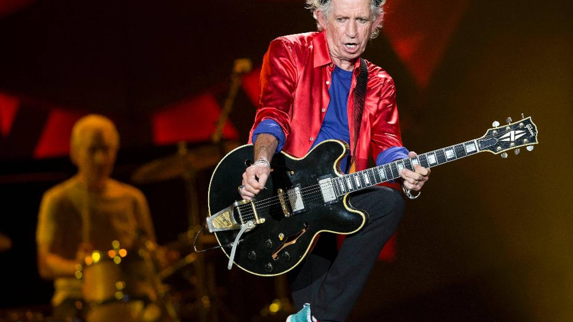 """In this Tuesday, June 9, 2015, file photo, the Rolling Stones' Keith Richards, foreground, and Charlie Watts, background on drums, perform at Bobby Dodd Stadium on the Georgia Tech campus, in Atlanta. Richards announced, Thursday, July 9, 2015, that he will release a new solo album, his first in 20 years, entitled """"Crosseyed Heart,"""" on Sept. 18, 2015. (AP)"""