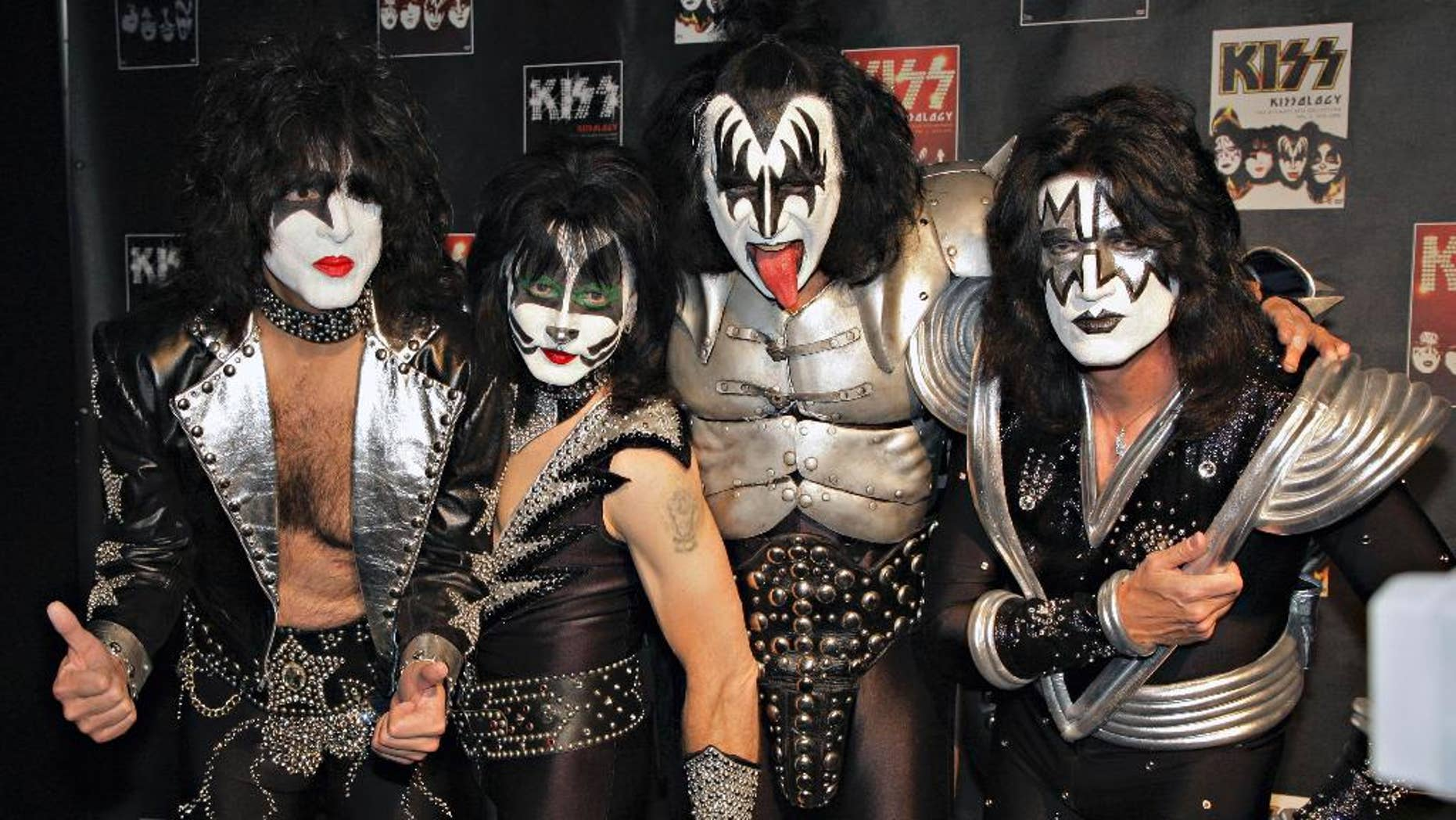 """May 8, 2008 file photo, members of Kiss, from left, Paul Stanley, Eric Singer, Gene Simmons and Tommy Thayer, poses for a photograph during a news conference to promote the start of their """"KISS Alive/35"""" European Tour  in Oberhausen, Germany."""