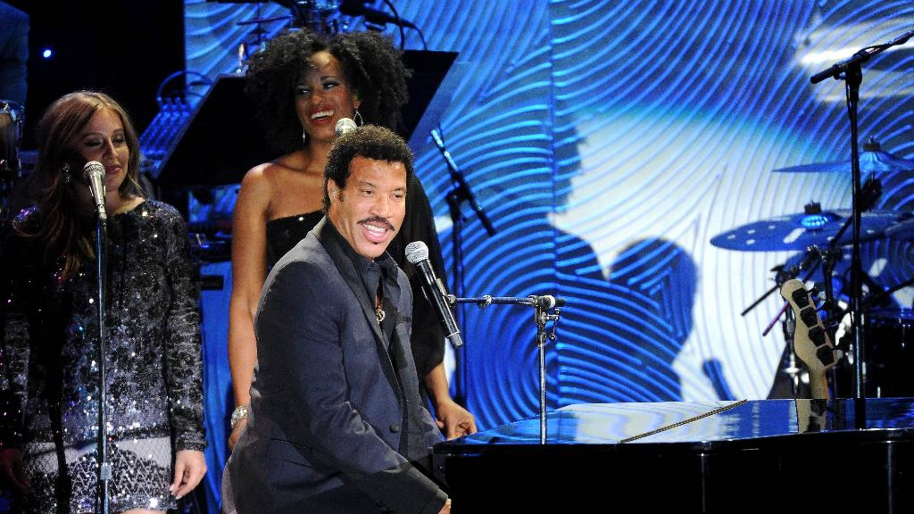 """FILE - In this Jan. 25, 2014 file photo, recording artist Lionel Richie performs onstage at The 56th Annual GRAMMY Awards Salute to Industry Icons with Clive Davis, at the Beverly Hilton Hotel in Beverly Hills, Richie is keeping busy with his """"All the Hits All Night Long"""" tour, which kicks off its second North American leg May 29, 2014, in Vancouver. (Photo by Frank Micelotta/Invision/AP, file)"""