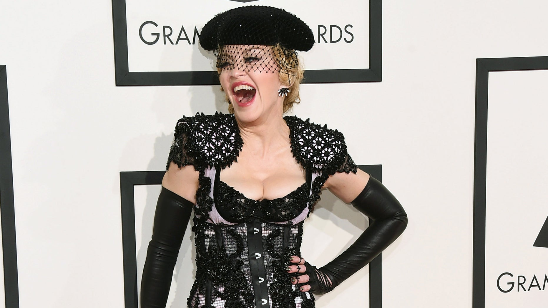 FILE - In this Feb. 8, 2015 file photo, Madonna arrives at the 57th annual Grammy Awards in Los Angeles. The pop icon will launch her Rebel Heart Tour this fall, which includes more than 60 shows across North America, Europe, Australia and Asia. (Photo by Jordan Strauss/Invision/AP, File)