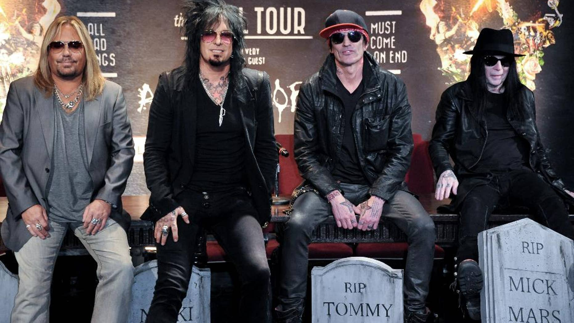 """FILE - This Jan. 28, 2014 file photo shows, from left, Vince Neil, Nikki Sixx, Tommy Lee, and Mick Mars of Motley Crue at a press conference in Los Angeles. Country artists including Rascal Flatts, Florida Georgia Line and Brantley Gilbert perform on the 15-song album """"Nashville Outlaws: A Tribute to Motley Crue,"""" released Tuesday, Aug. 19. (Photo by Richard Shotwell/Invision/AP, File)"""