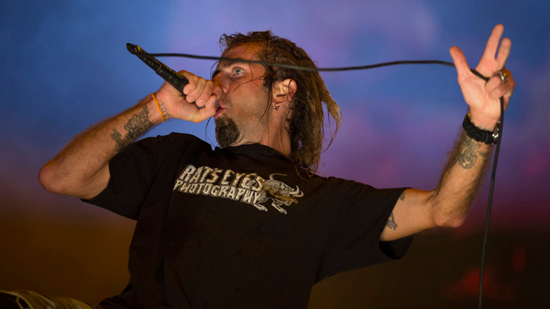 In this Sept. 24, 2015 photo, Randy Blythe of the heavy metal group Lamb of God performs at the Rock in Rio music festival in Rio de Janeiro, Brazil.