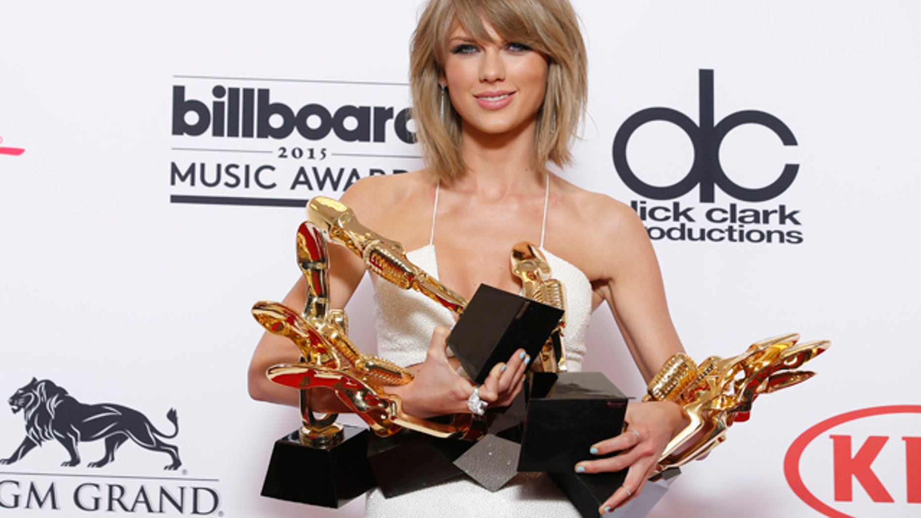 FILE - In a May 17, 2015 file photo, Taylor Swift poses in the press room with the awards for top Billboard 200 album for '1989', top female artist, chart achievement, top artist, top Billboard 200 artist, top hot 100 artist, top digital song artist, and top streaming song (video) for 'Shake It Off' at the Billboard Music Awards at the MGM Grand Garden Arena, in Las Vegas. (Photo by Eric Jamison/Invision/AP, File)
