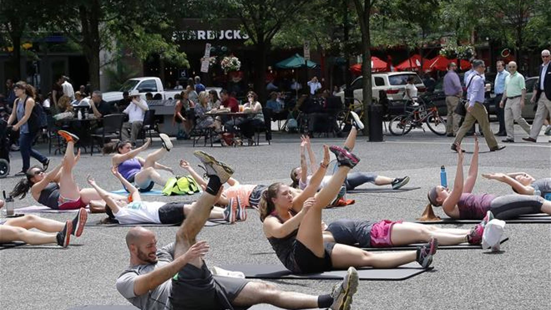 An exercise group from a YMCA in downtown Pittsburgh takes part in high-intensity interval training.