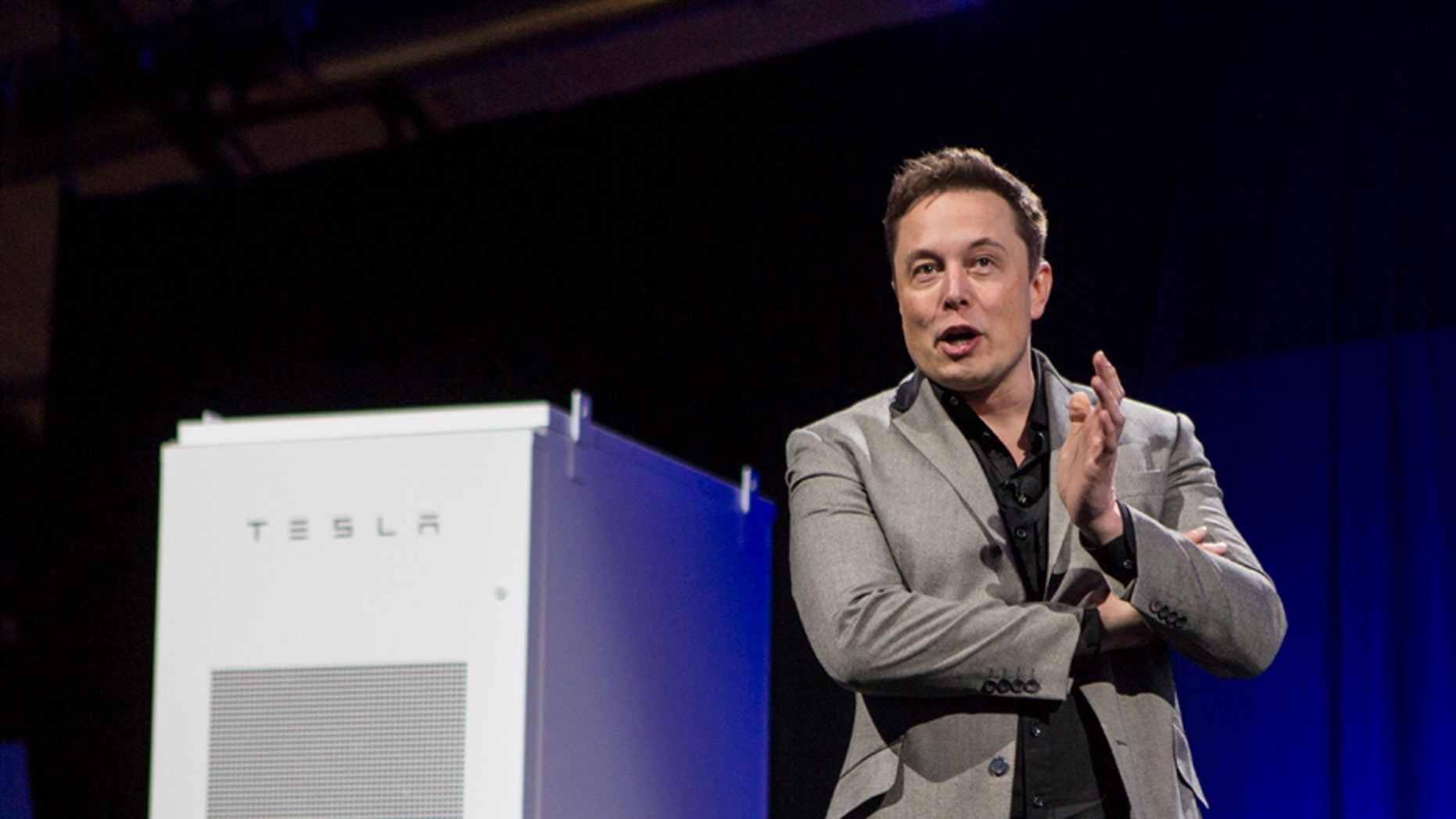 Elon Musk, CEO of Tesla Motors Inc., unveils the company's newest product, Powerpack in Hawthorne, Calif., Thursday, April. 30, 2015.