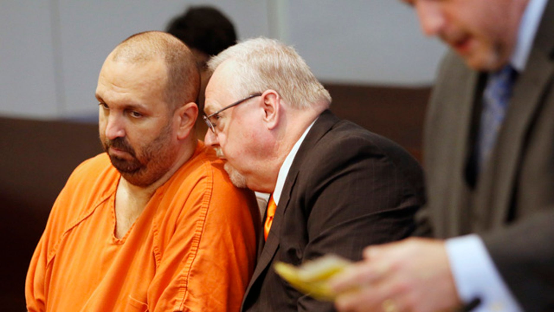 April 6, 2015: Murder defendant Craig Stephen Hicks, 46, left, listens to his co-defense counsel Terry Alford, center, during a death penalty hearing for Hicks in Durham Criminal Superior Court in Durham, N.C.  (AP Photo/The News & Observer, Harry Lynch)