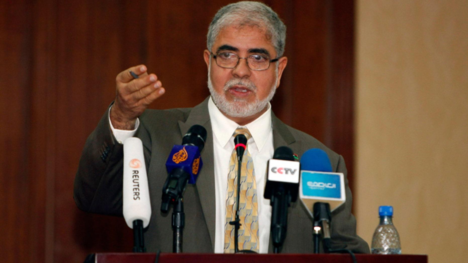 Dec. 4, 2011: Libya's Deputy Prime Minister Mustafa Abushagur speaks at a news conference in Tripoli.