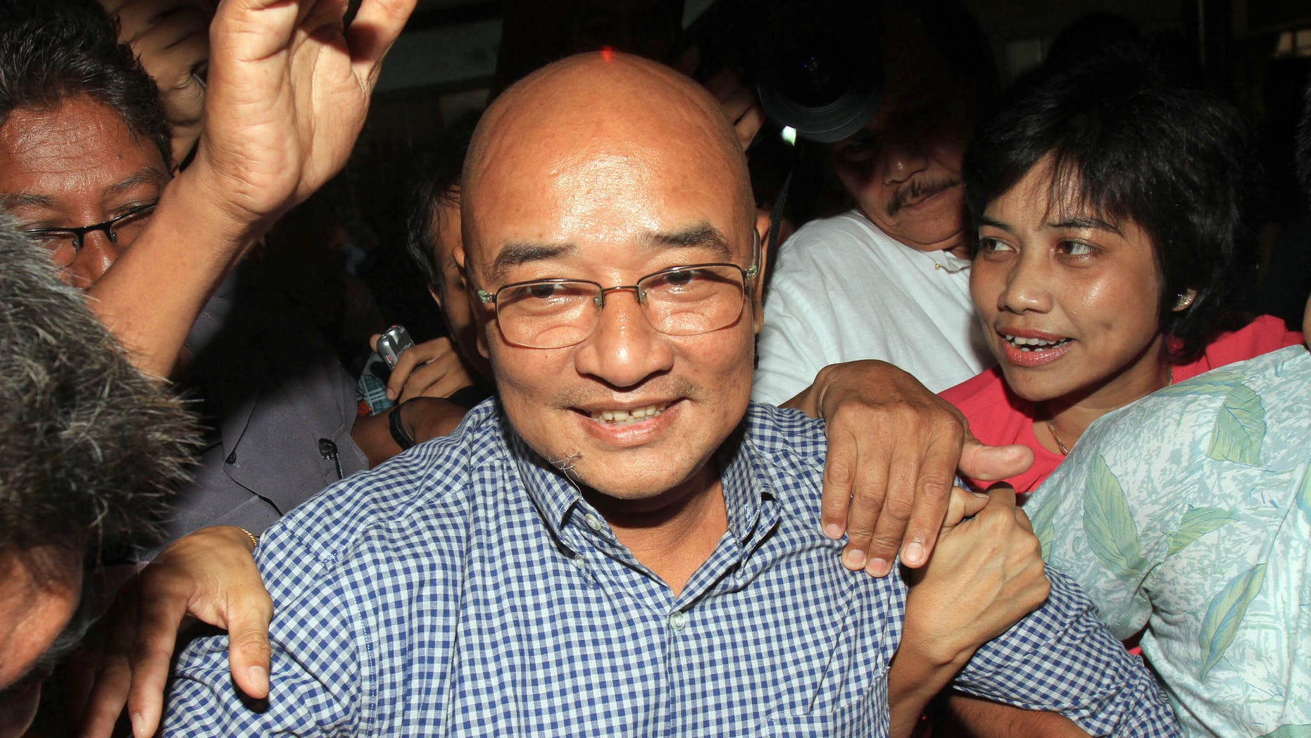 Myanmar's comedian and activist Zarganar, who was serving a 35-year sentence in Myitkyina prison in northernmost Kachin State, arrives at Yangon International Airport in Yangon, Myanmar, after he was released Wednesday, Oct. 12, 2011.