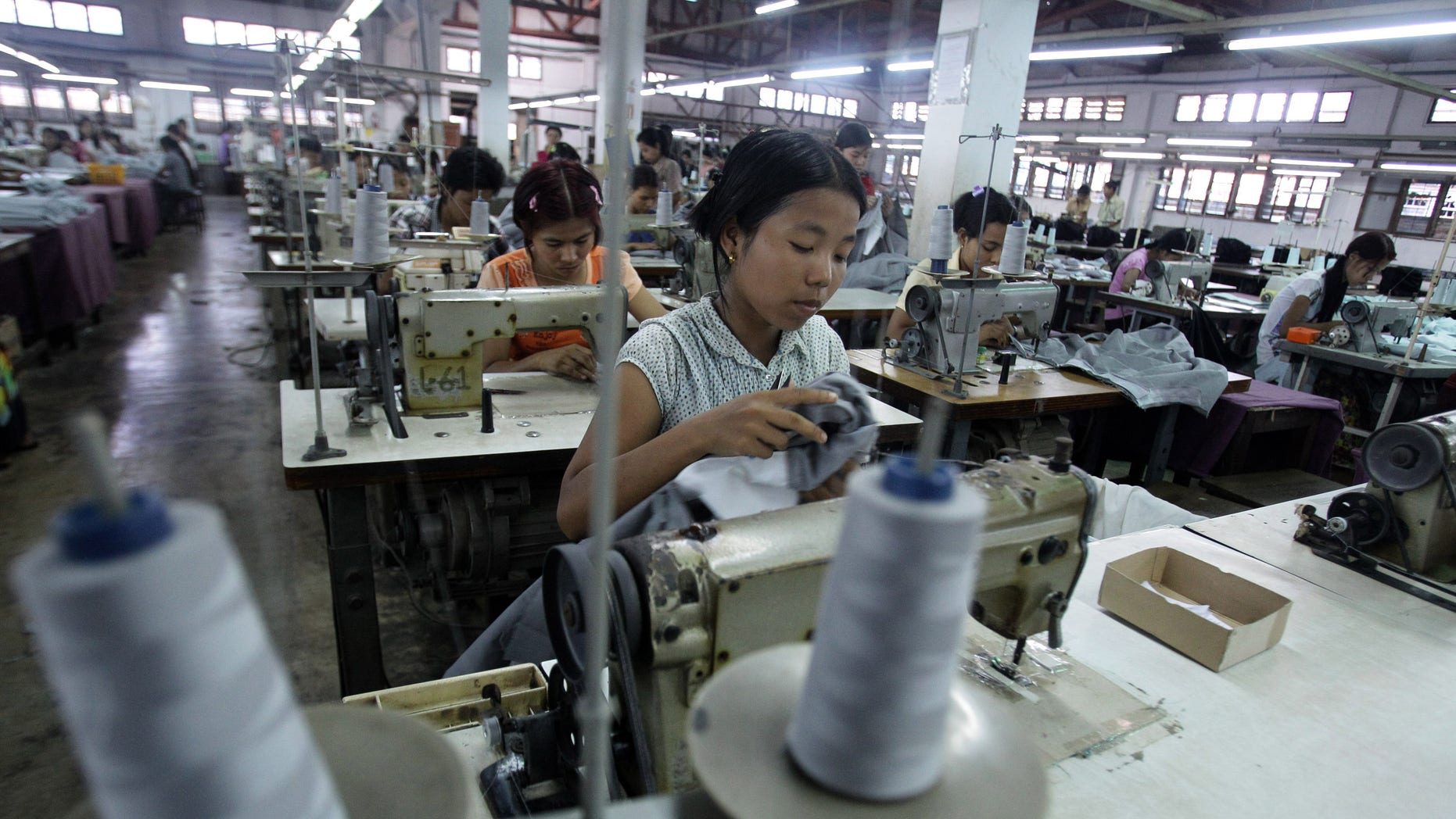 April 21:  Young workers use sewing machines at a garment factory in Yangon, Myanmar.