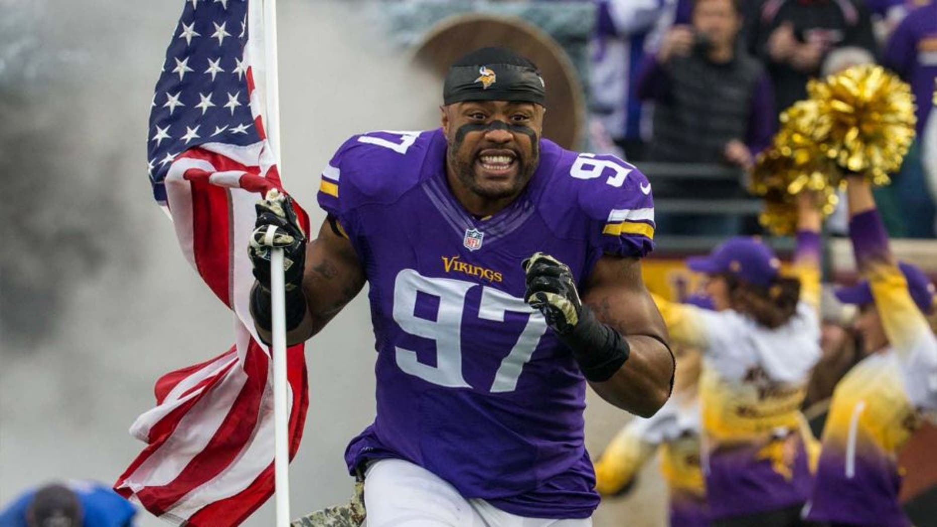 Sunday, November 23: Minnesota Vikings defensive end Everson Griffen carries the American flag on the field prior to the game against the Green Bay Packers at TCF Bank Stadium.