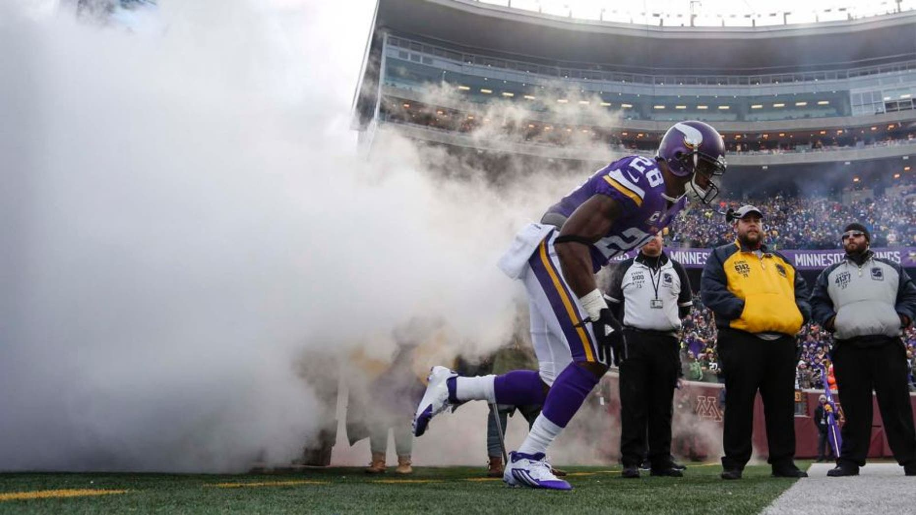 Sunday, Nov. 22: Minnesota Vikings running back Adrian Peterson comes onto the field out of a cloud of smoke to play the Green Bay Packers at TCF Bank Stadium in Minneapolis.