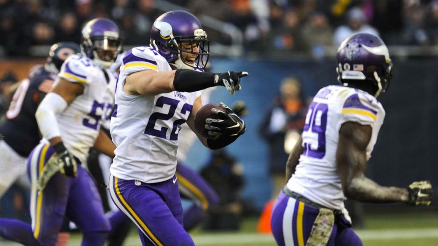 Sunday, November 16: Minnesota Vikings free safety Harrison Smith (center) intercepts a throw from Chicago Bears quarterback Jay Cutler (not pictured) in the second half of their game at Soldier Field. The Bears won 21-13.