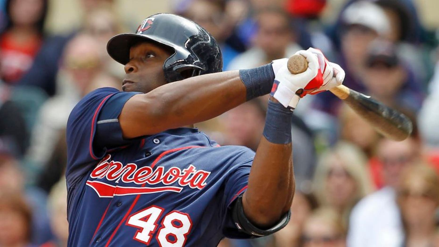 Sunday, May 31: The Minnesota Twins' Torii Hunter follows through on a two-run double off Toronto Blue Jays relief pitcher Roberto Osuna during the seventh inning in Minneapolis.