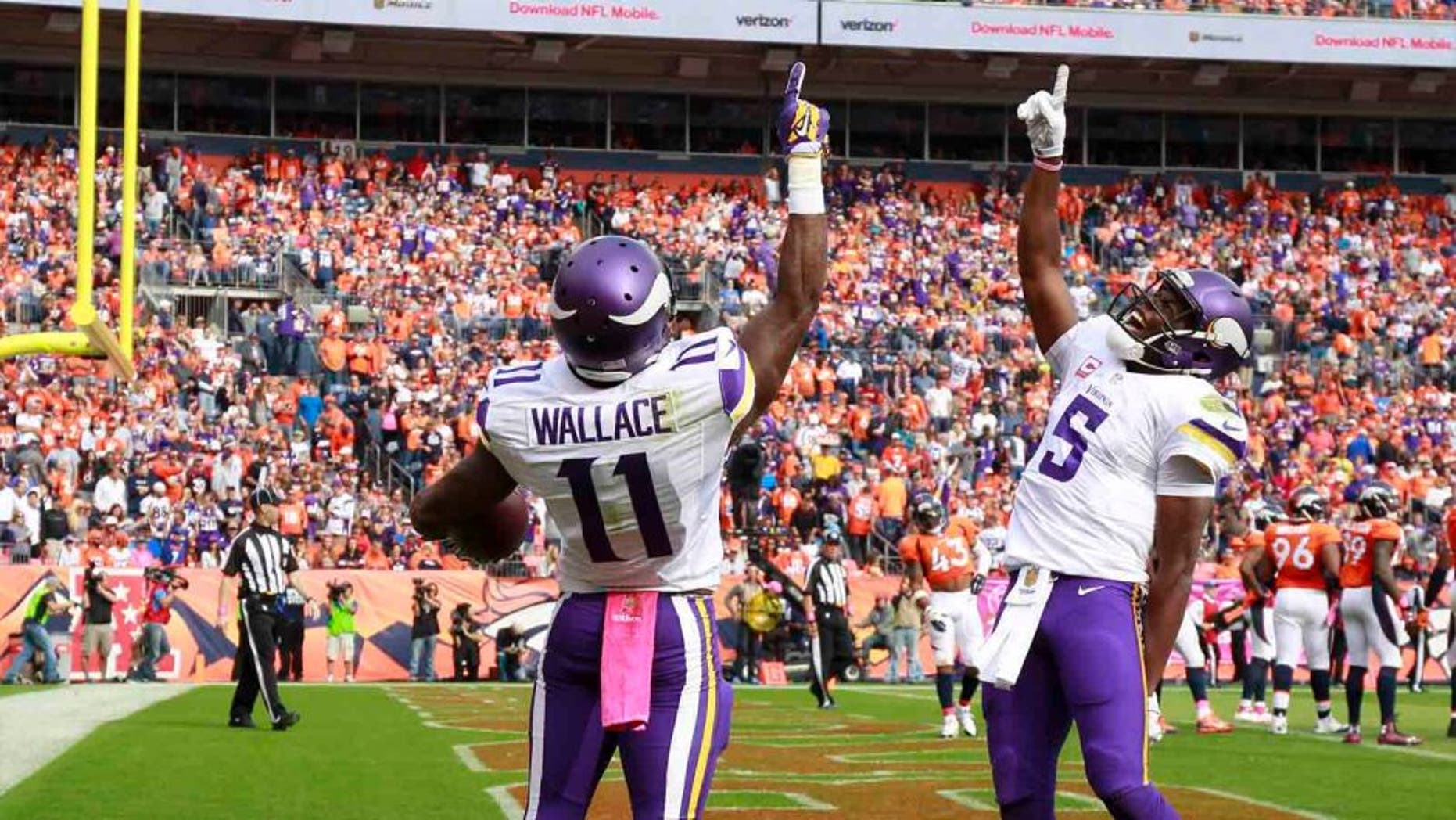Sunday, Oct. 4: Minnesota Vikings wide receiver Mike Wallace celebrates after scoring with quarterback Teddy Bridgewater during the first half against the Denver Broncos.