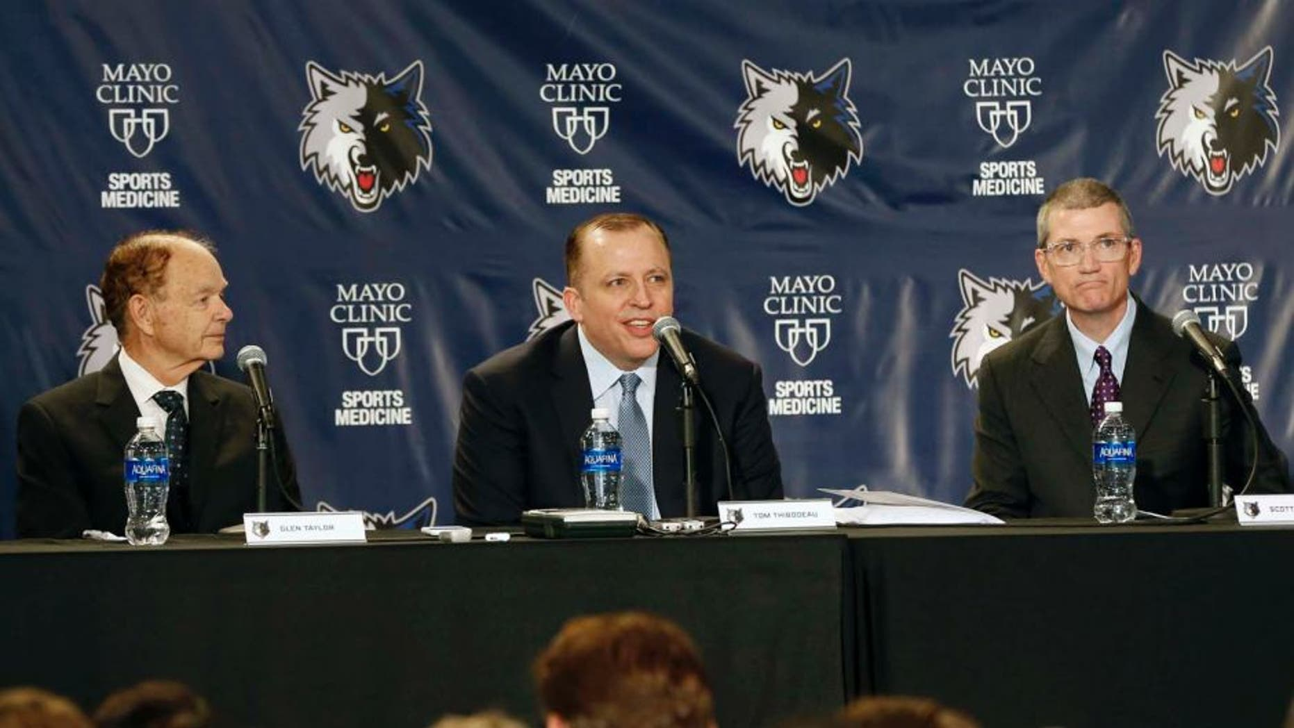 Tuesday, April 26: Tom Thibodeau (center) addresses the media and a gathering of fans after he was introduced as the new Minnesota Timberwolves head coach. At left is Timberwolves owner Glen Taylor. At right is new general manager Scott Layden who was also introduced.