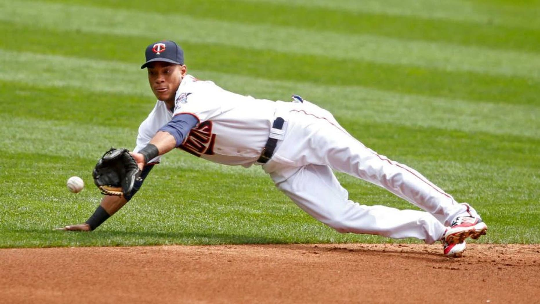 Thursday, Aug. 25, 2016: Minnesota Twins shortstop Jorge Polanco dives for a single by Detroit Tigers catcher James McCann (not pictured) in the second inning at Target Field. The Twins lost 8-5.