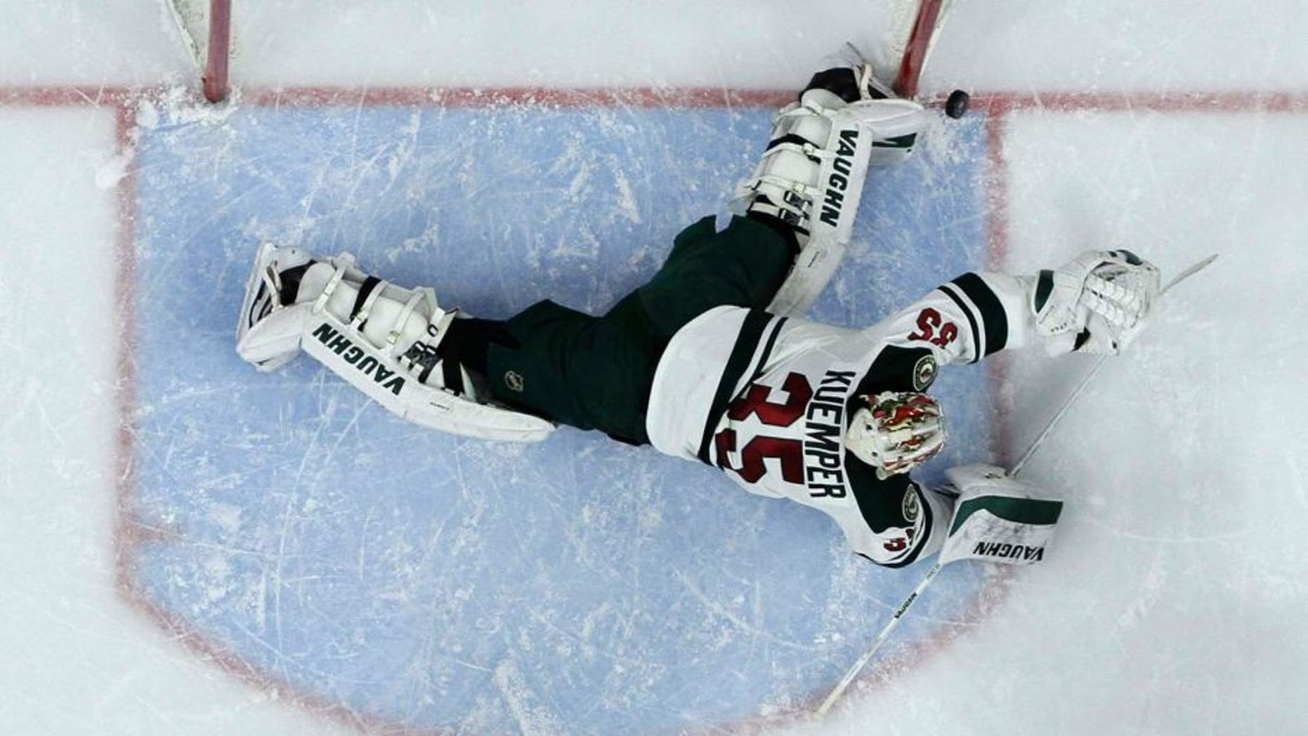Thursday, November 20: The Minnesota Wild's Darcy Kuemper blocks a shot during the second period against the Philadelphia Flyers. The Wild won 3-2.