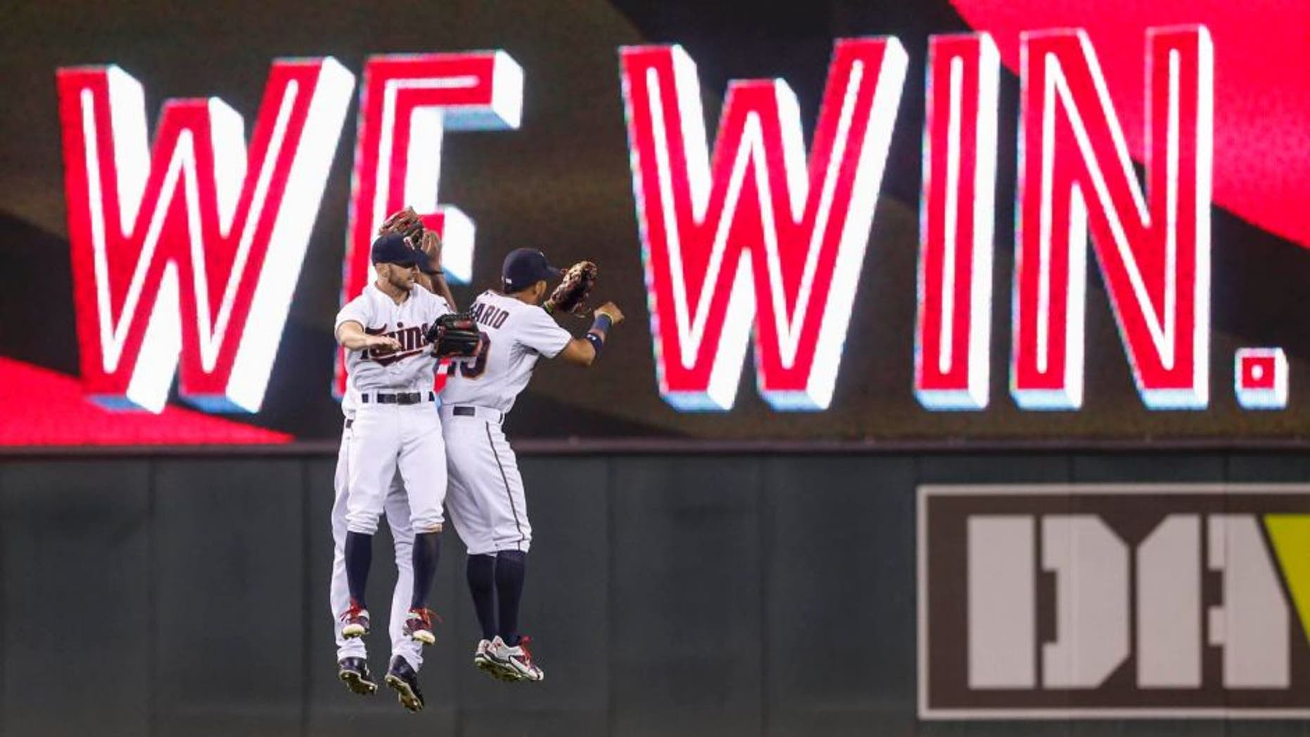 Friday, Aug. 28: Minnesota Twins left fielder Shane Robinson (left), center fielder Byron Buxton (back) and right fielder Eddie Rosario celebrate the 3-0 win over the Houston Astros at Target Field.