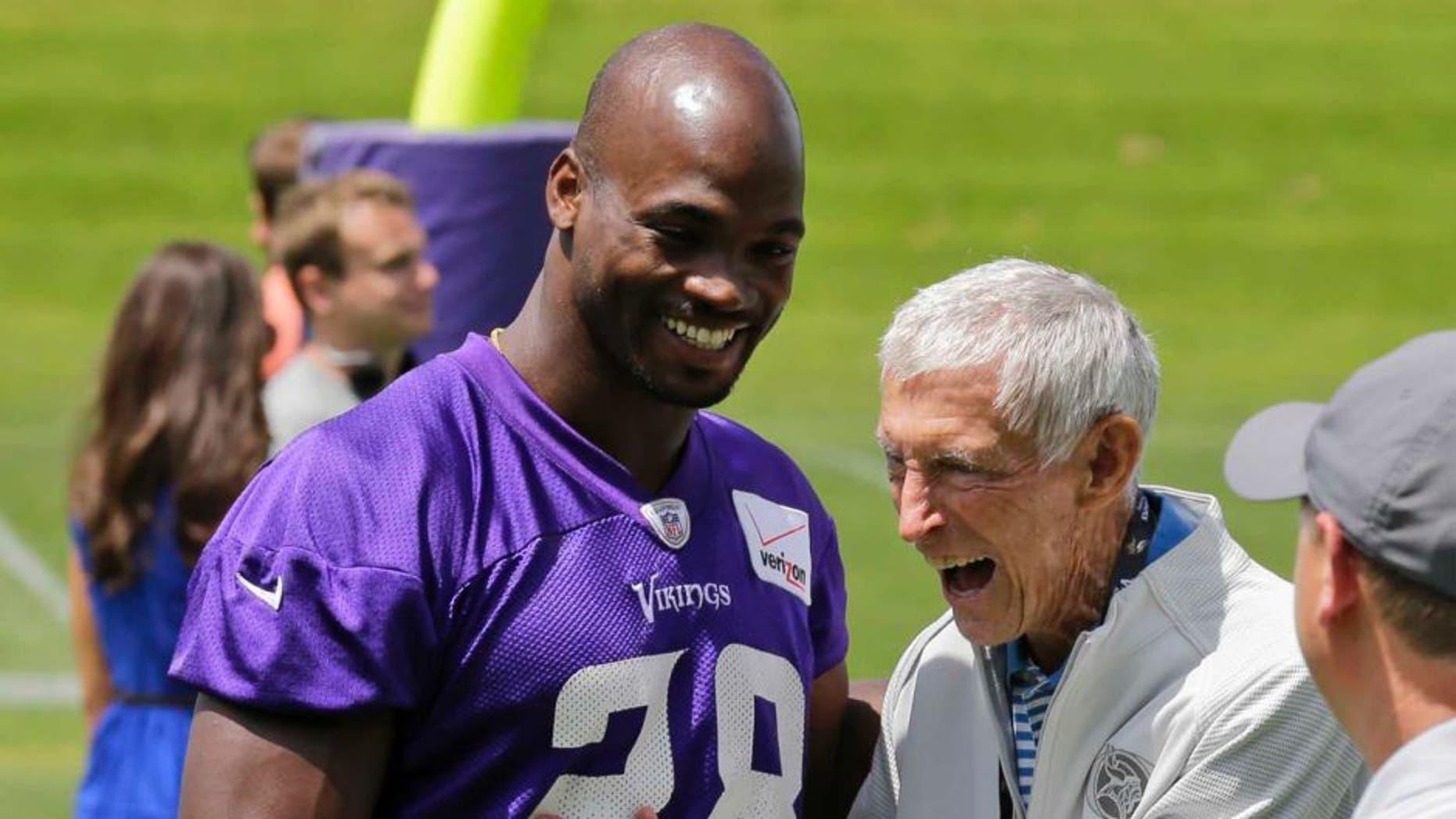 Thursday, June 18: Minnesota Vikings running back Adrian Peterson (left) laughs with former Vikings head coach Jerry Burns during minicamp in Eden Prairie, Minn.