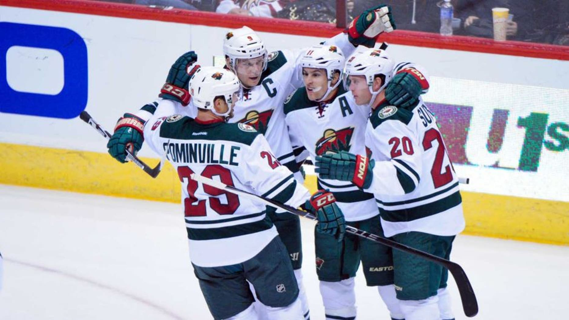 Thursday, Oct. 15: Minnesota Wild left wing Zach Parise (second from right) celebrates with right wing Jason Pominville (left), defenseman Ryan Suter (right) and center Mikko Koivu after scoring a power play goal in the first period against the Arizona Coyotes at Gila River Arena.