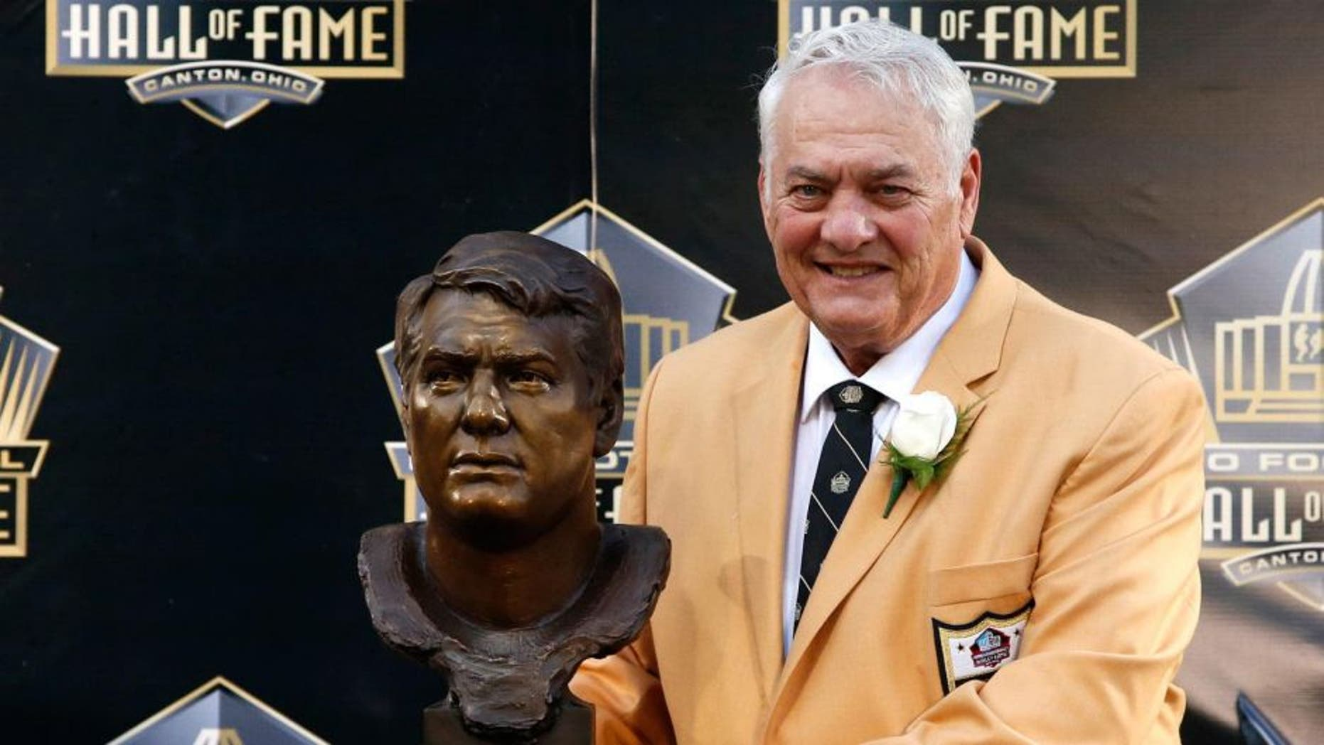 Saturday, August 8: Former Minnesota Vikings player Mick Tingelhoff poses with his bust during inductions at the Pro Football Hall of Fame in Canton, Ohio.